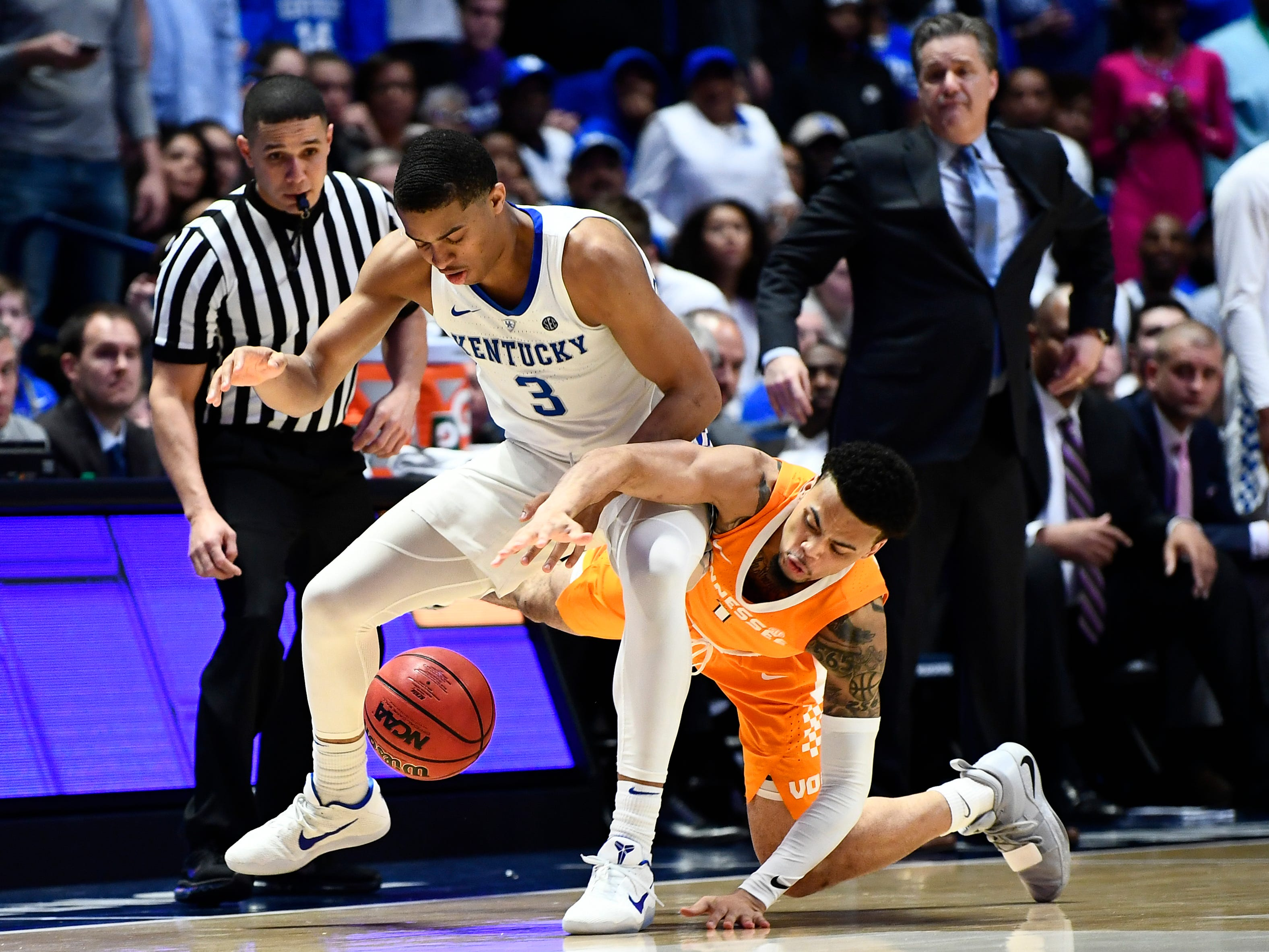 Tennessee guard Lamonte Turner (1) and Kentucky guard Keldon Johnson (3) fight for a loose ball in the last minute of Tennessee's game against Kentucky in the SEC Tournament held at Bridgestone Arena in Nashville on Saturday, March 16, 2019.