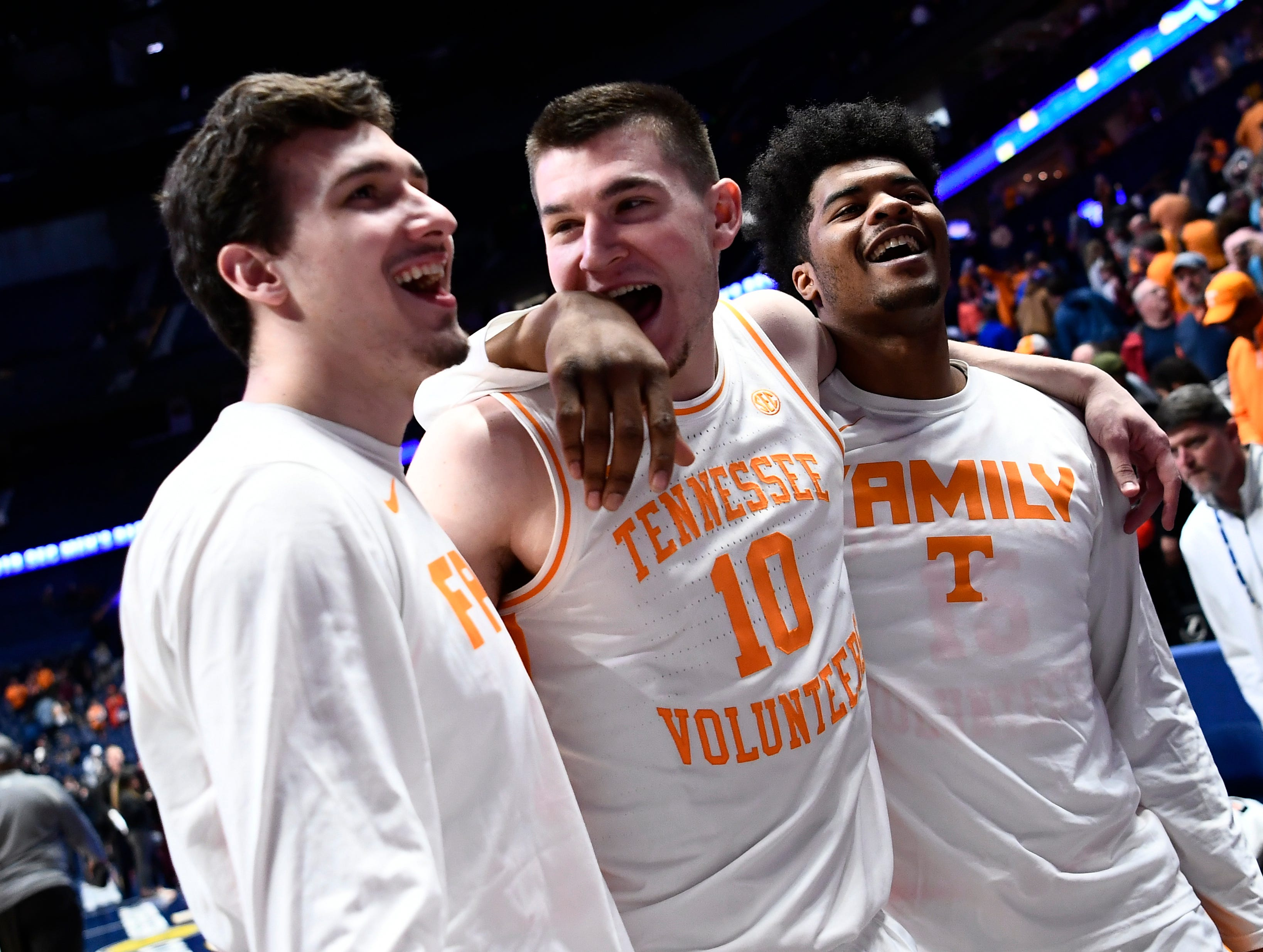Tennessee forward John Fulkerson (10) walks off the court with forward Brock Jancek (34) and forward Derrick Walker (15) after beating Mississippi State in the  SEC Men's Basketball Tournament at Bridgestone Arena in Nashville, Tenn., Friday, March 15, 2019.
