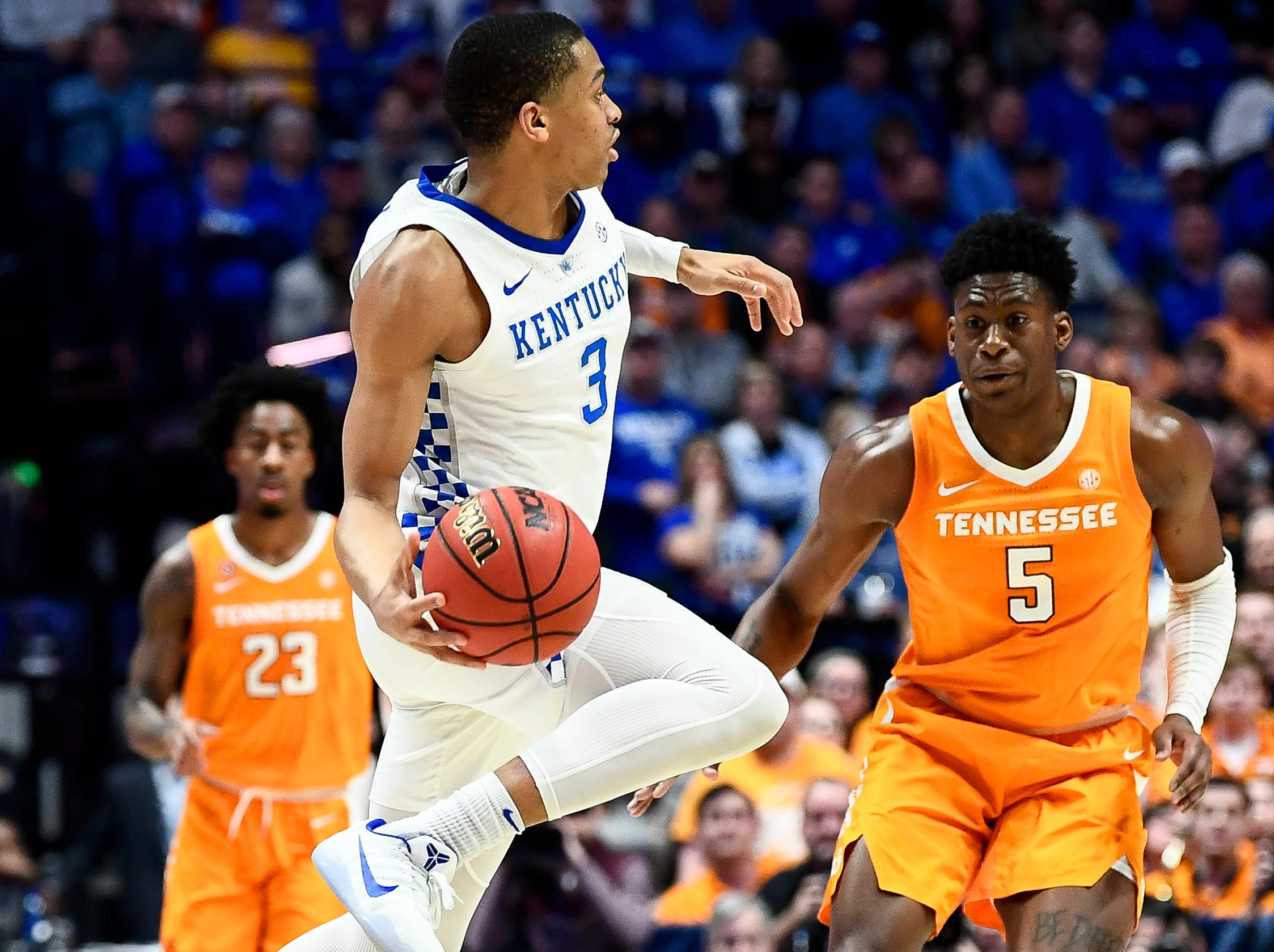 Kentucky guard Keldon Johnson (3) passes past Tennessee guard Admiral Schofield (5) during the first half of the SEC Men's Basketball Tournament semifinal game at Bridgestone Arena in Nashville, Tenn., Saturday, March 16, 2019.