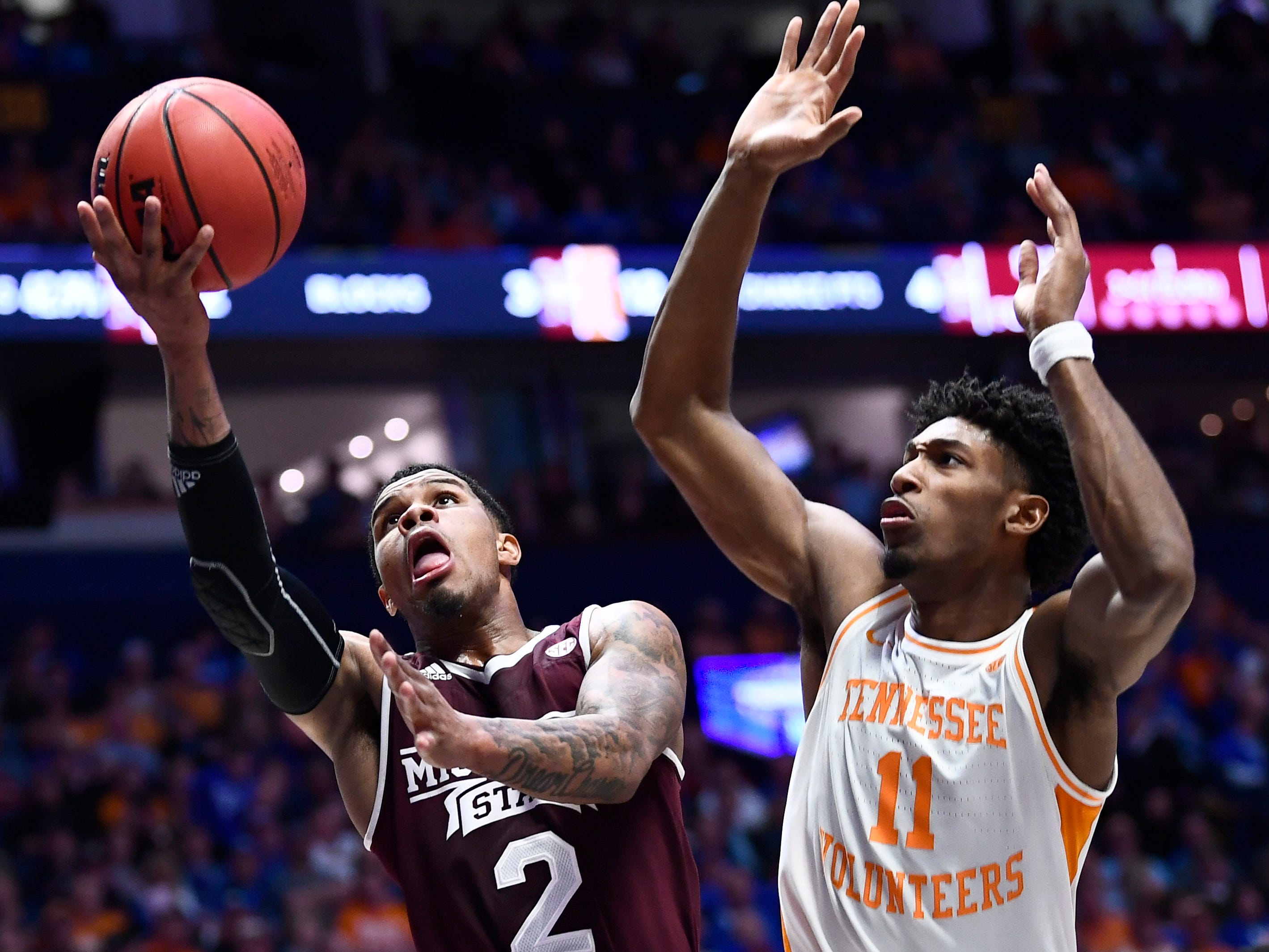 Mississippi State guard Lamar Peters (2) goes to the basket defended by Tennessee forward Kyle Alexander (11) during the first half of the SEC Men's Basketball Tournament game at Bridgestone Arena in Nashville, Tenn., Friday, March 15, 2019.