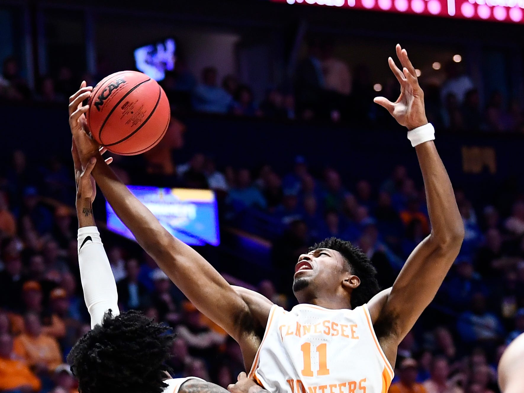Tennessee forward Kyle Alexander (11) grabs a rebound with guard Jordan Bowden (23) during the first half of the SEC Men's Basketball Tournament game at Bridgestone Arena in Nashville, Tenn., Friday, March 15, 2019.