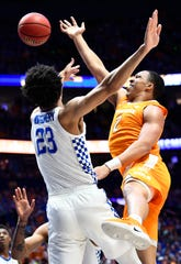 Tennessee forward Grant Williams (2) shoots over Kentucky forward EJ Montgomery (23) during the first half of the SEC Men's Basketball Tournament semifinal game at Bridgestone Arena in Nashville, Tenn., Saturday, March 16, 2019.
