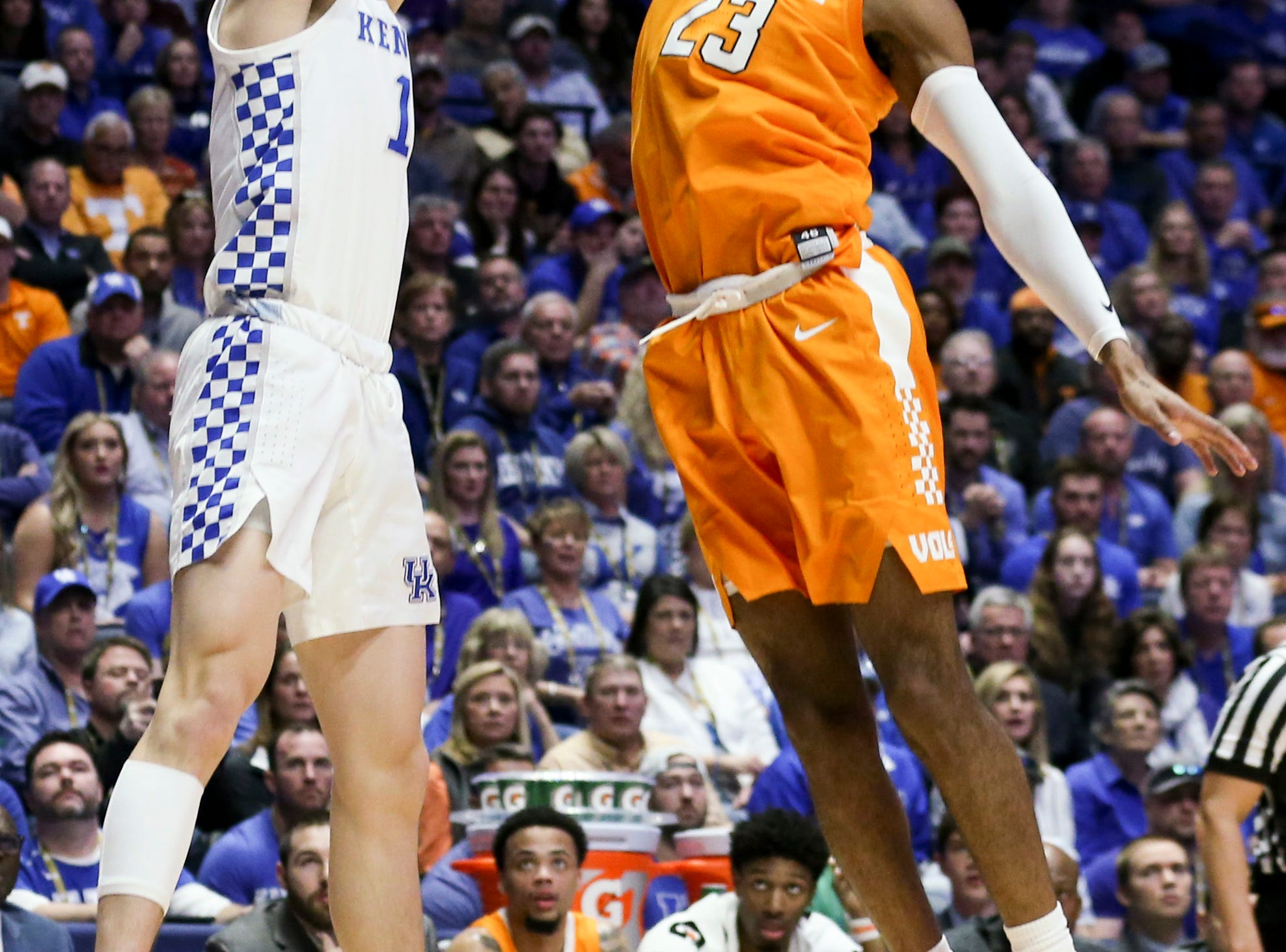 Tennessee guard Jordan Bowden (23) defends against Kentucky guard Tyler Herro (14) during the first half of the SEC Men's Basketball Tournament semifinal game at Bridgestone Arena in Nashville, Tenn., Saturday, March 16, 2019.