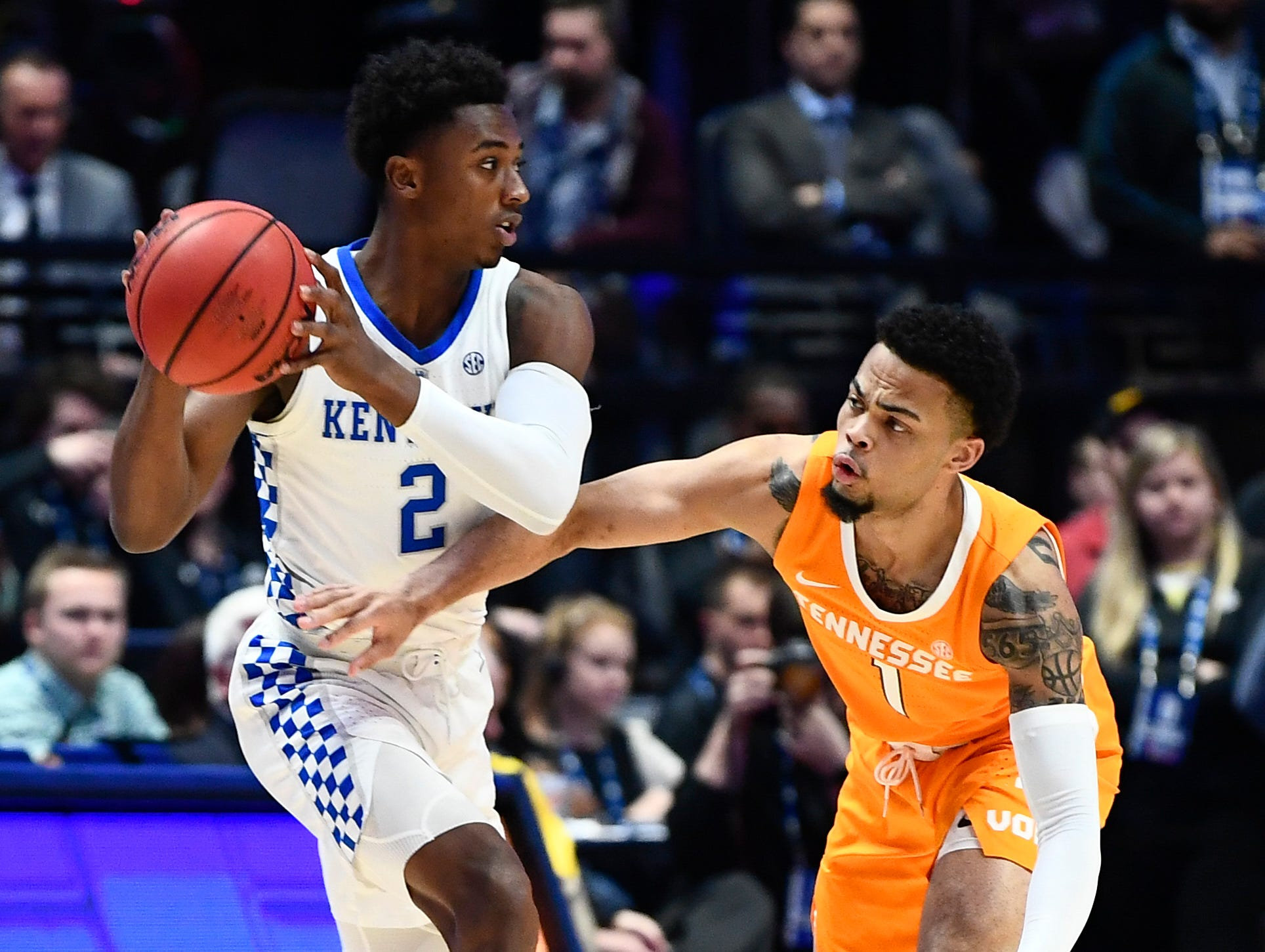 Tennessee guard Lamonte Turner (1) defends against Kentucky guard Ashton Hagans (2) during the first half of the SEC Men's Basketball Tournament semifinal game at Bridgestone Arena in Nashville, Tenn., Saturday, March 16, 2019.