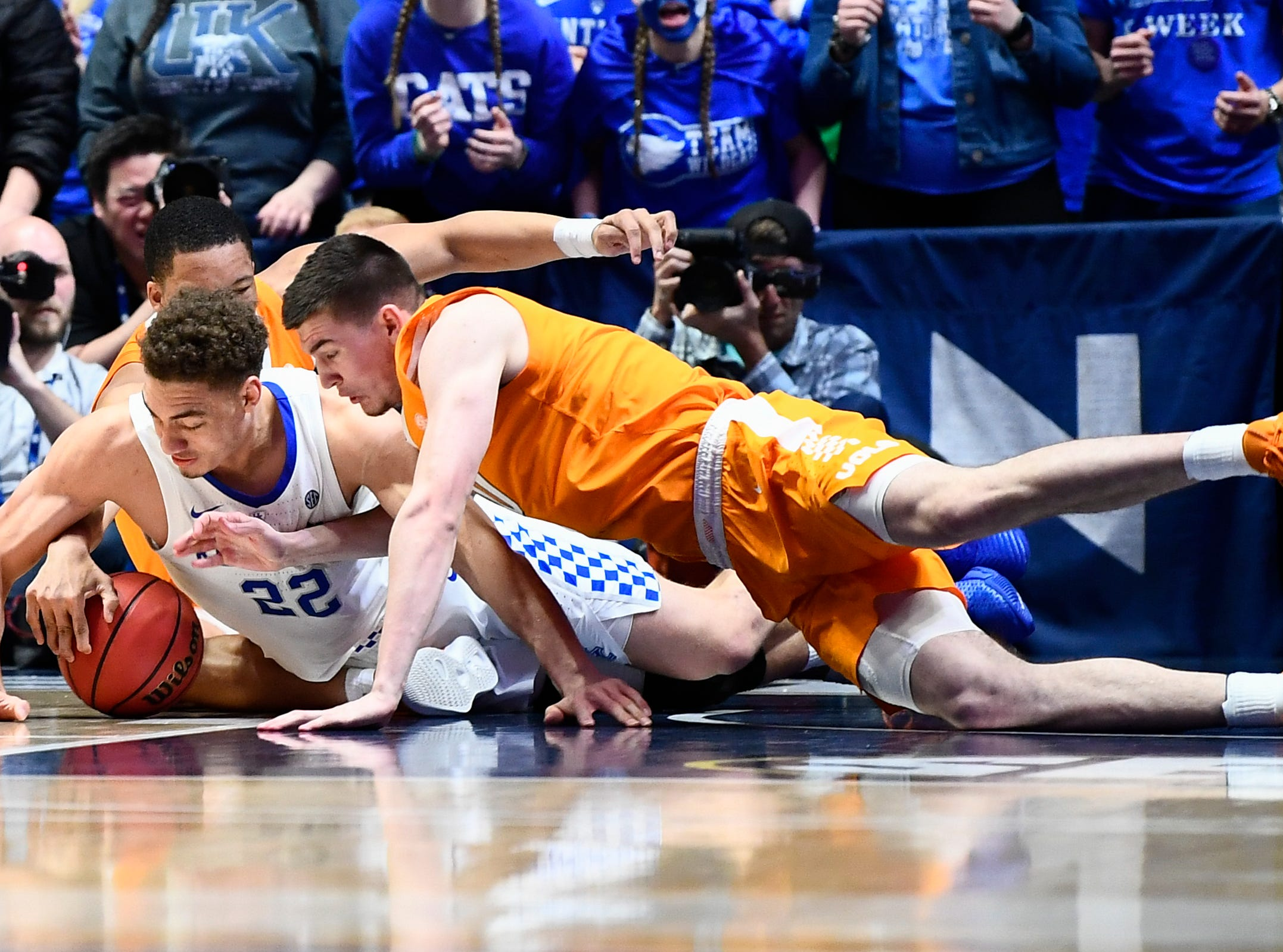 Tennessee forward John Fulkerson (10) dives for the ball with Kentucky forward Reid Travis (22) during the second half of the SEC Men's Basketball Tournament semifinal game at Bridgestone Arena in Nashville, Tenn., Saturday, March 16, 2019.