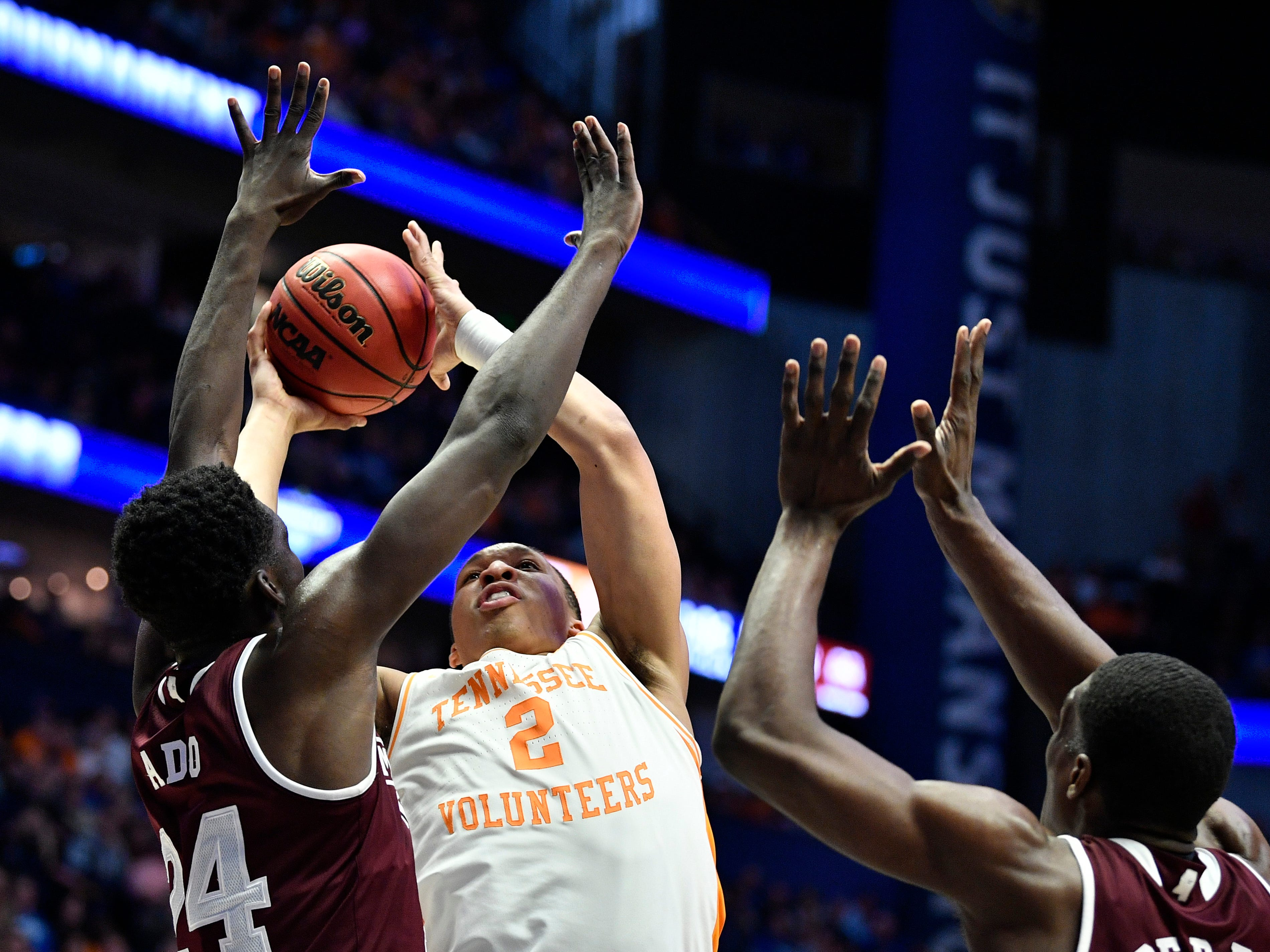 Tennessee forward Grant Williams (2) goes up for a shot defended by Mississippi State forwards Abdul Ado (24) and Reggie Perry (1) during the first half of the SEC Men's Basketball Tournament game at Bridgestone Arena in Nashville, Tenn., Friday, March 15, 2019.