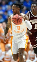 Tennessee guard Jordan Bone (0) moves the ball defended by Mississippi State forward Reggie Perry (1) during the first half of the SEC Men's Basketball Tournament game at Bridgestone Arena in Nashville, Tenn., Friday, March 15, 2019.
