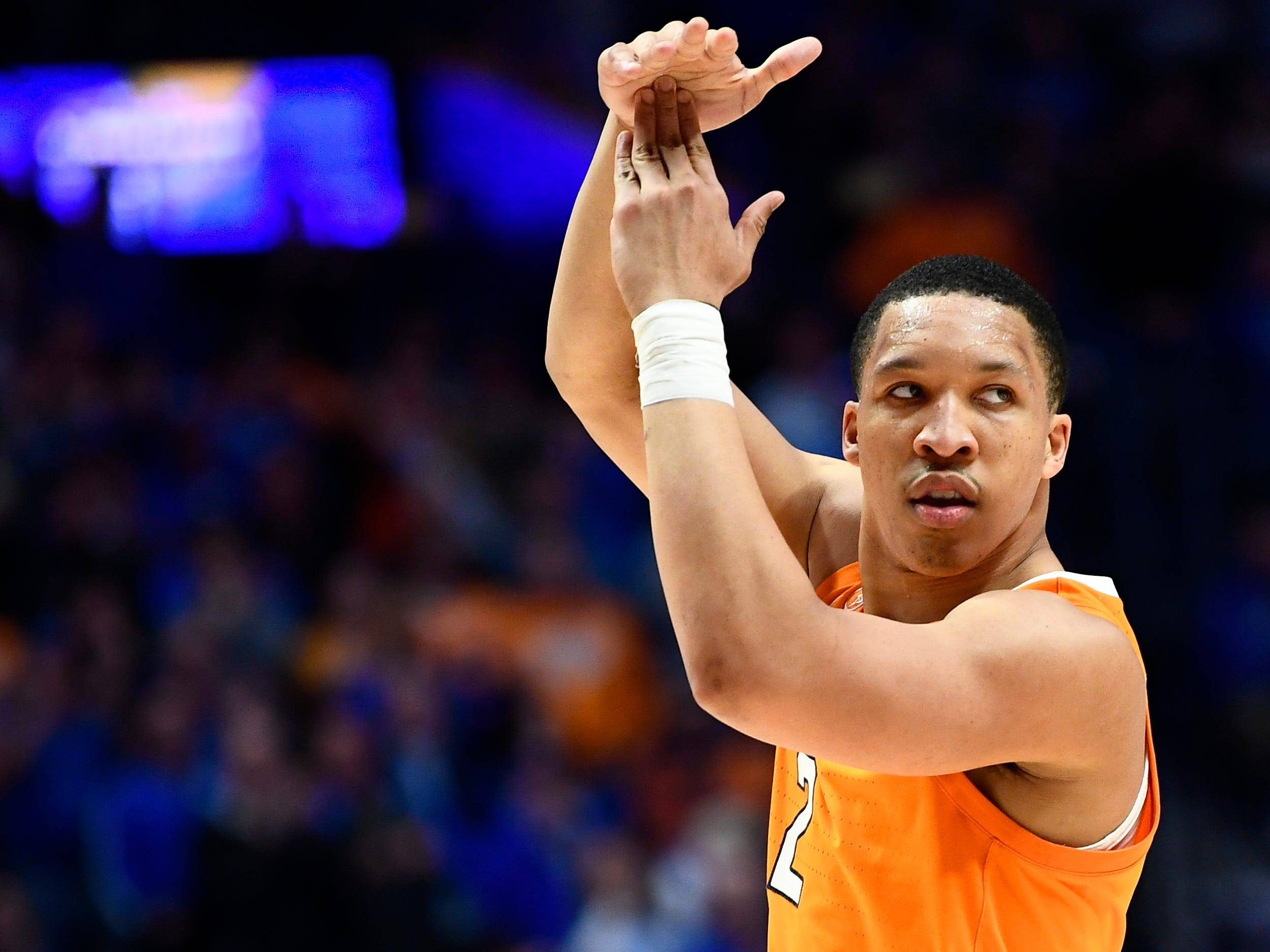 Tennessee forward Grant Williams (2) calls for a time-out during the second half of the SEC Men's Basketball Tournament semifinal game against Kentucky at Bridgestone Arena in Nashville, Tenn., Saturday, March 16, 2019.