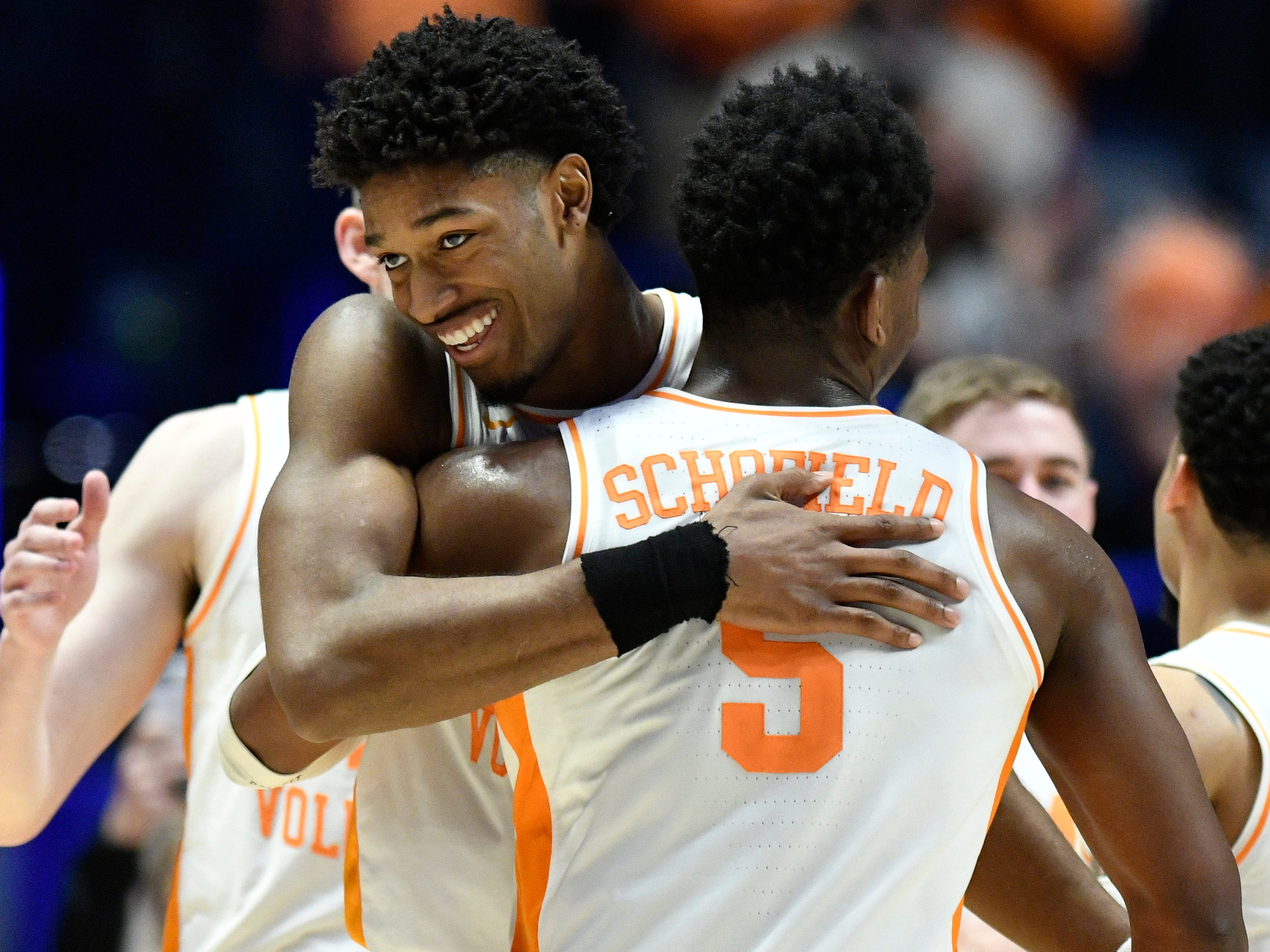 Tennessee forward Kyle Alexander (11) and guard Admiral Schofield (5) celebrate after the win over Mississippi State in the SEC Men's Basketball Tournament at Bridgestone Arena in Nashville, Tenn., Friday, March 15, 2019.