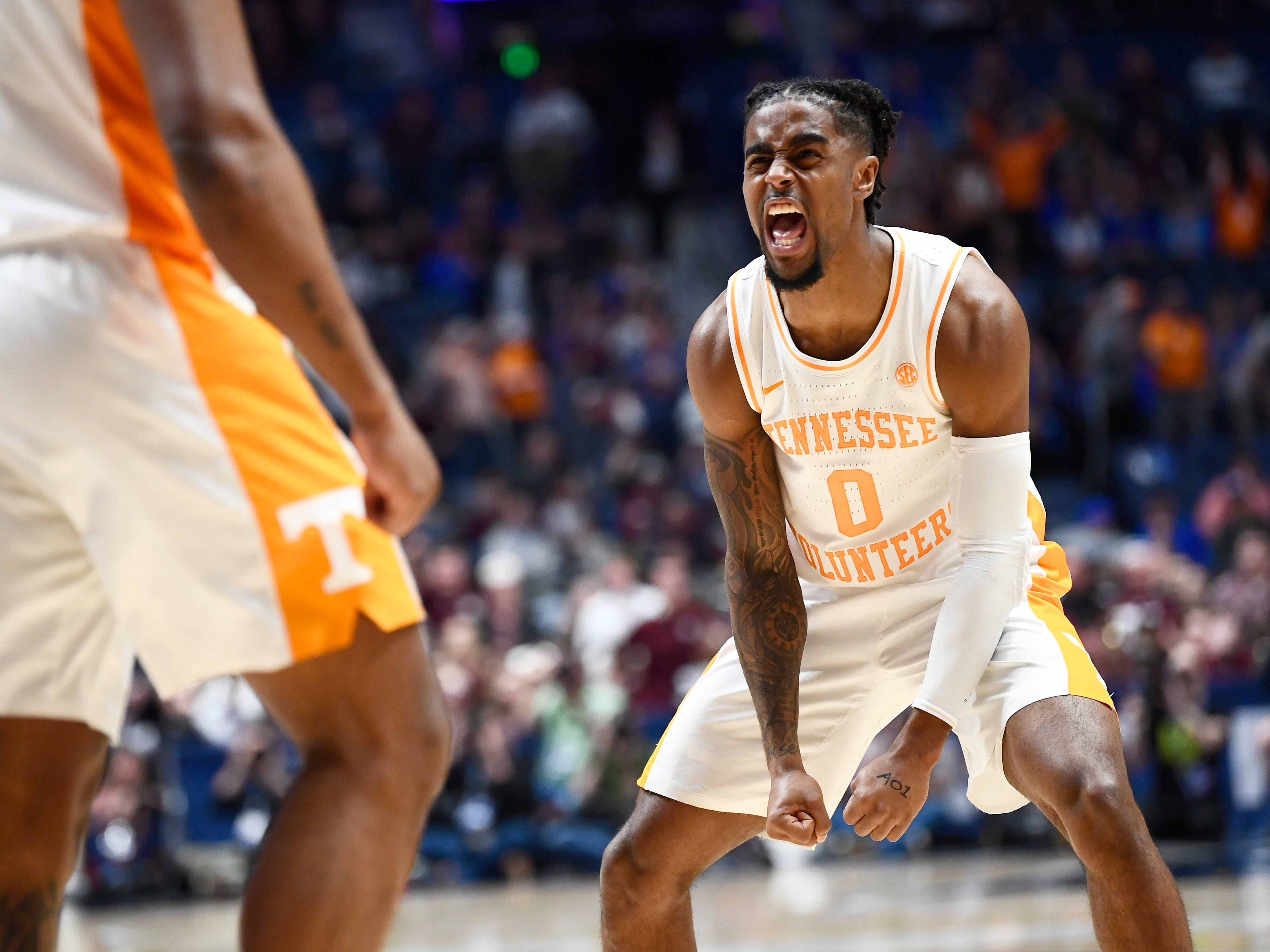 Tennessee guard Jordan Bone (0) reacts to a dunk by guard Admiral Schofield (5) during the second half of the SEC Men's Basketball Tournament game against Mississippi State at Bridgestone Arena in Nashville, Tenn., Friday, March 15, 2019.