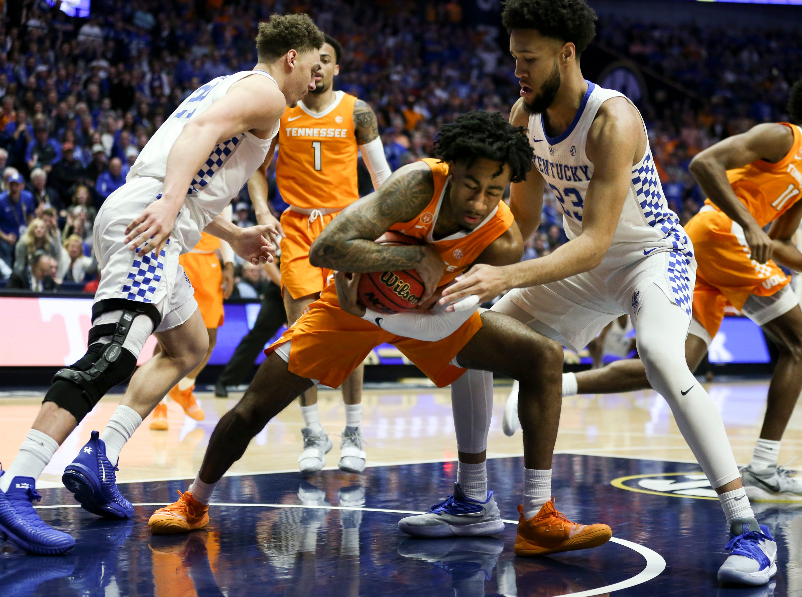 Tennessee guard Jordan Bowden (23)  battles Kentucky forward EJ Montgomery (23) during the first half of the SEC Men's Basketball Tournament semifinal game at Bridgestone Arena in Nashville, Tenn., Saturday, March 16, 2019.