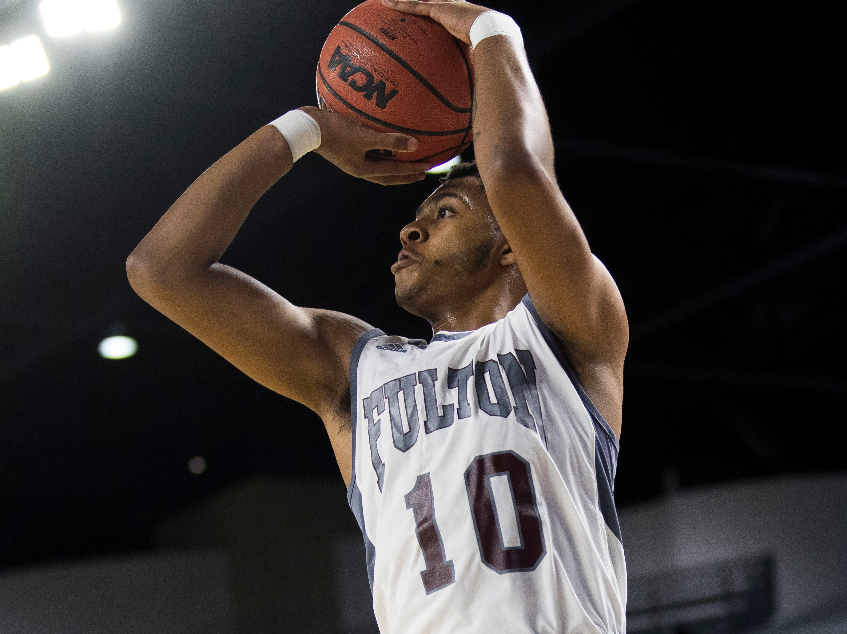 Fulton's Trey West (10) takes a shot during a TSSAA AA state championship game between Wooddale and Fulton at the Murphy Center in Murfreesboro, Saturday, March 16, 2019.