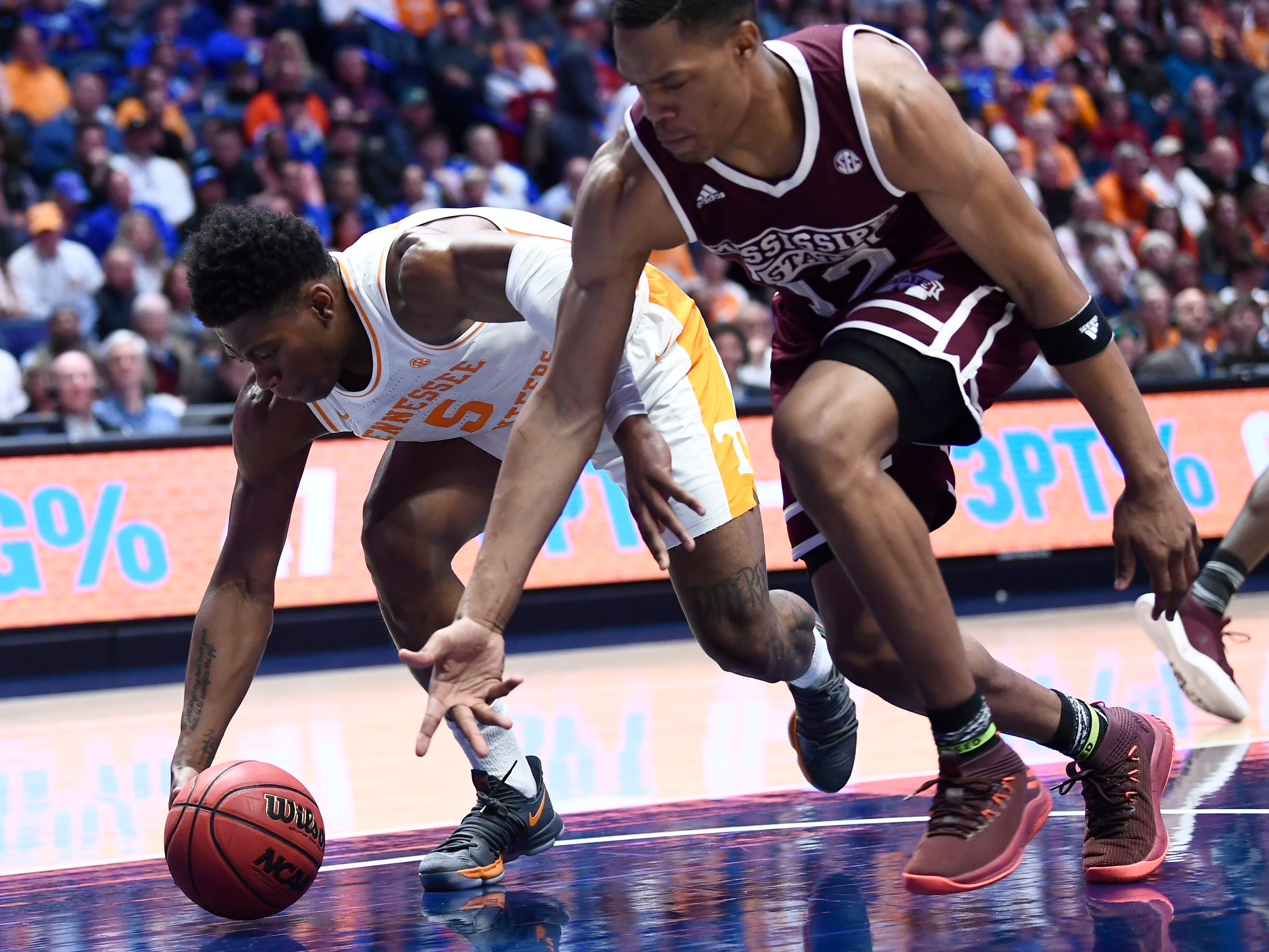 Tennessee guard Admiral Schofield (5) and Mississippi State guard Robert Woodard (12) battle for the ball during the first half of the SEC Men's Basketball Tournament game at Bridgestone Arena in Nashville, Tenn., Friday, March 15, 2019.