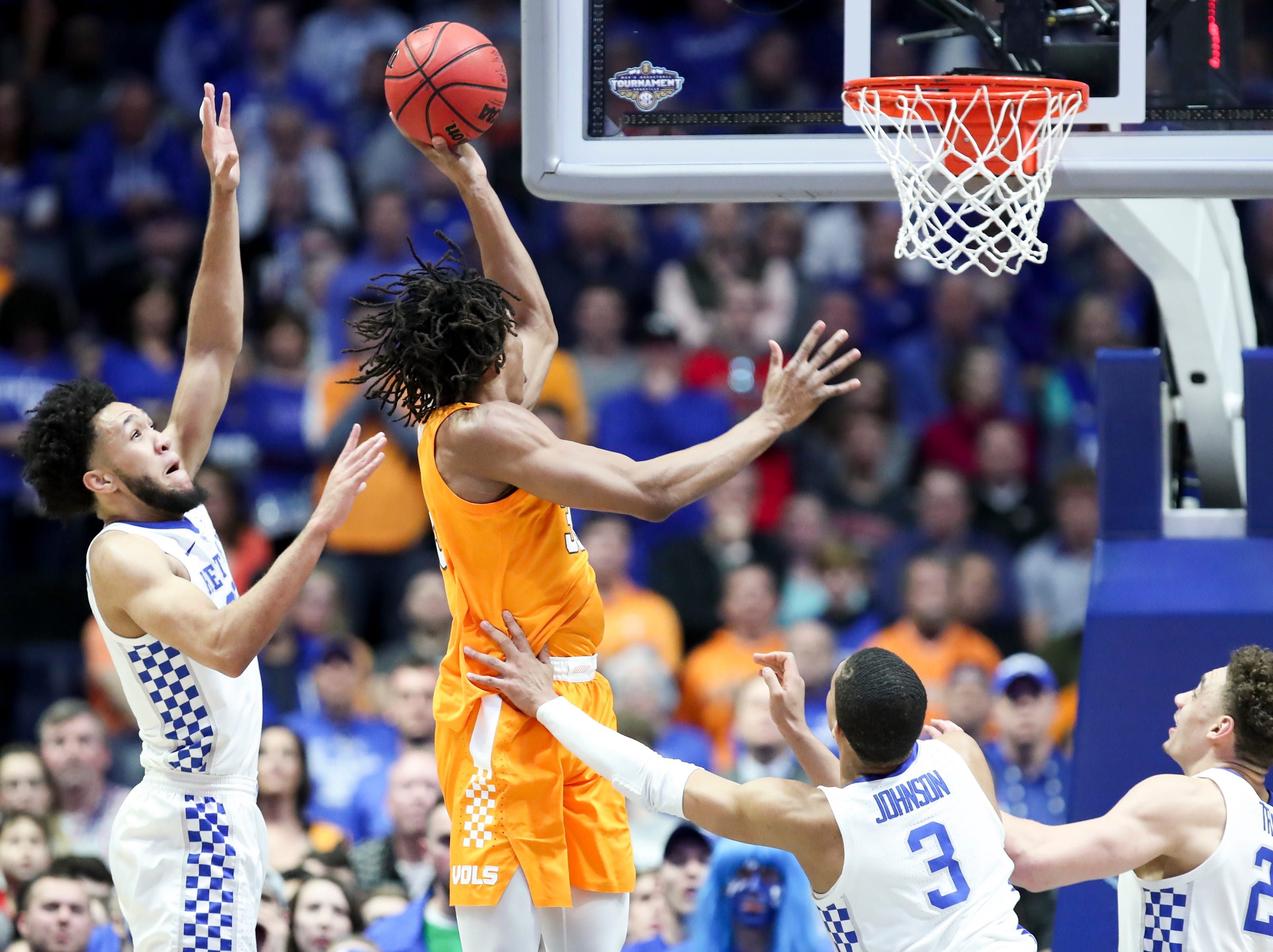 Tennessee forward Yves Pons (35) shoots past Kentucky forward EJ Montgomery (23) and guard Keldon Johnson (3) during the first half of the SEC Men's Basketball Tournament semifinal game at Bridgestone Arena in Nashville, Tenn., Saturday, March 16, 2019.