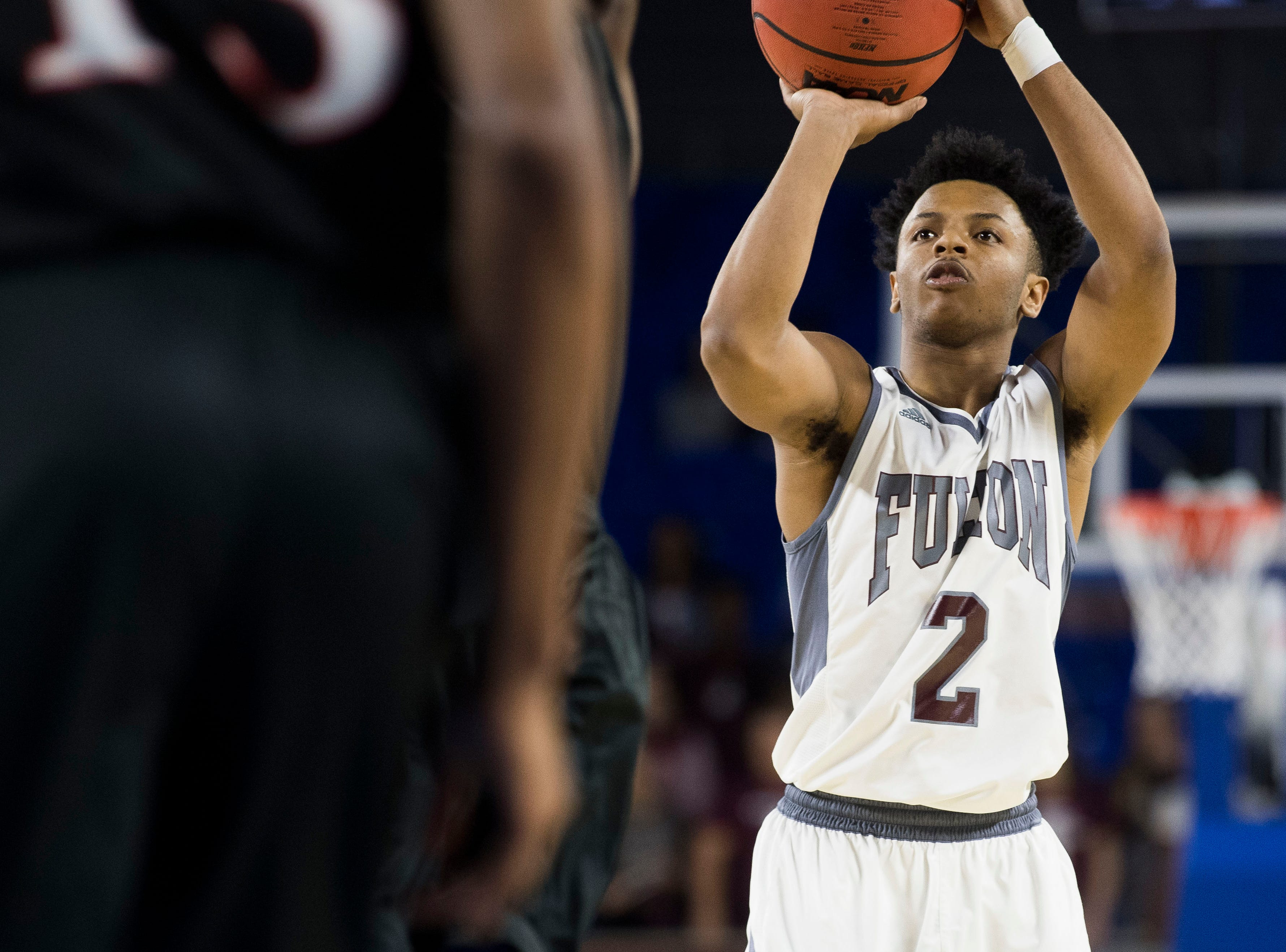 Fulton's Trey Davis (2) takes a shot during a TSSAA AA state championship game between Wooddale and Fulton at the Murphy Center in Murfreesboro, Saturday, March 16, 2019.