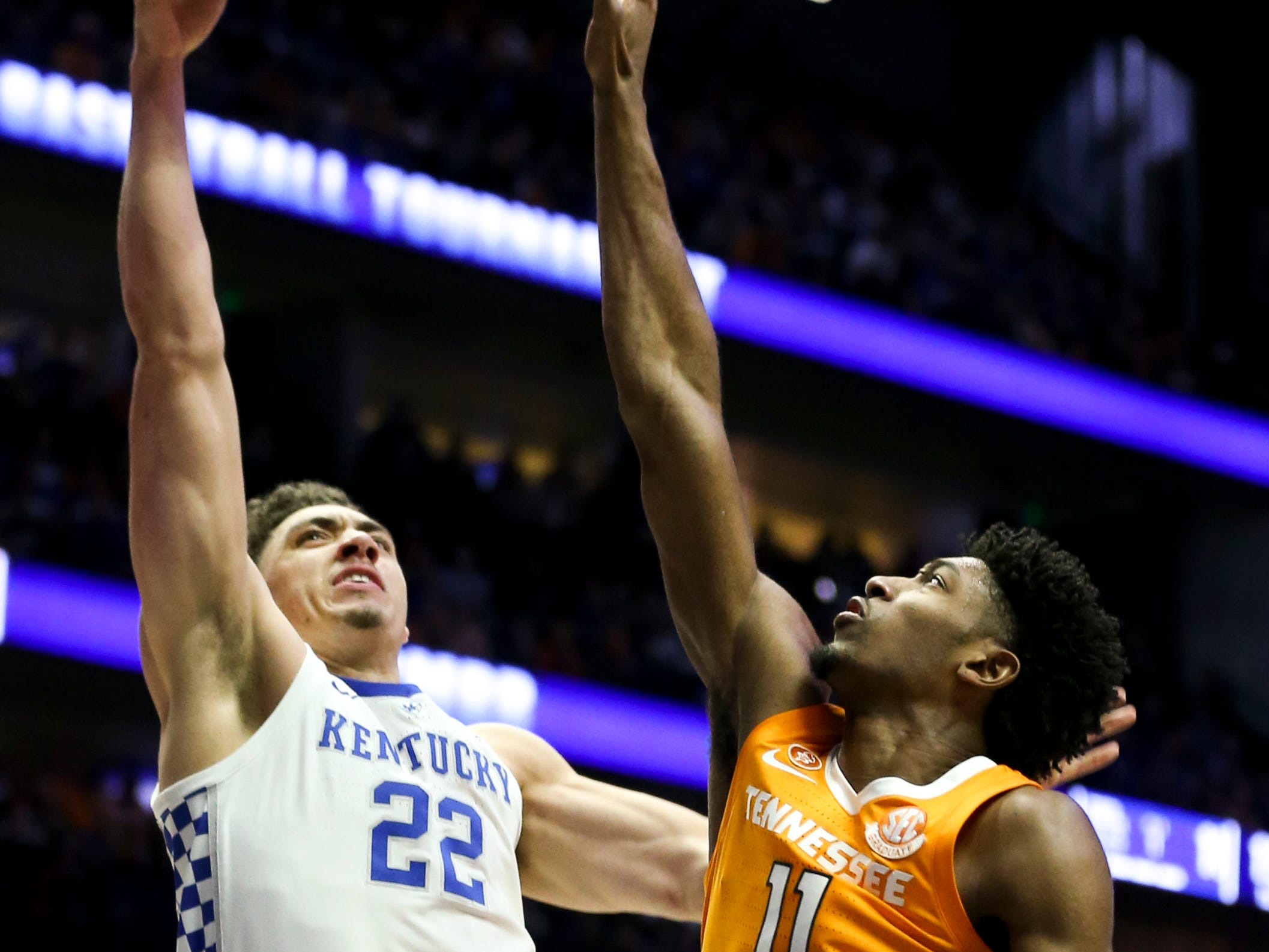 Kentucky forward Reid Travis (22) shoots against Tennessee forward Kyle Alexander (11) during the first half of the SEC Men's Basketball Tournament semifinal game at Bridgestone Arena in Nashville, Tenn., Saturday, March 16, 2019.