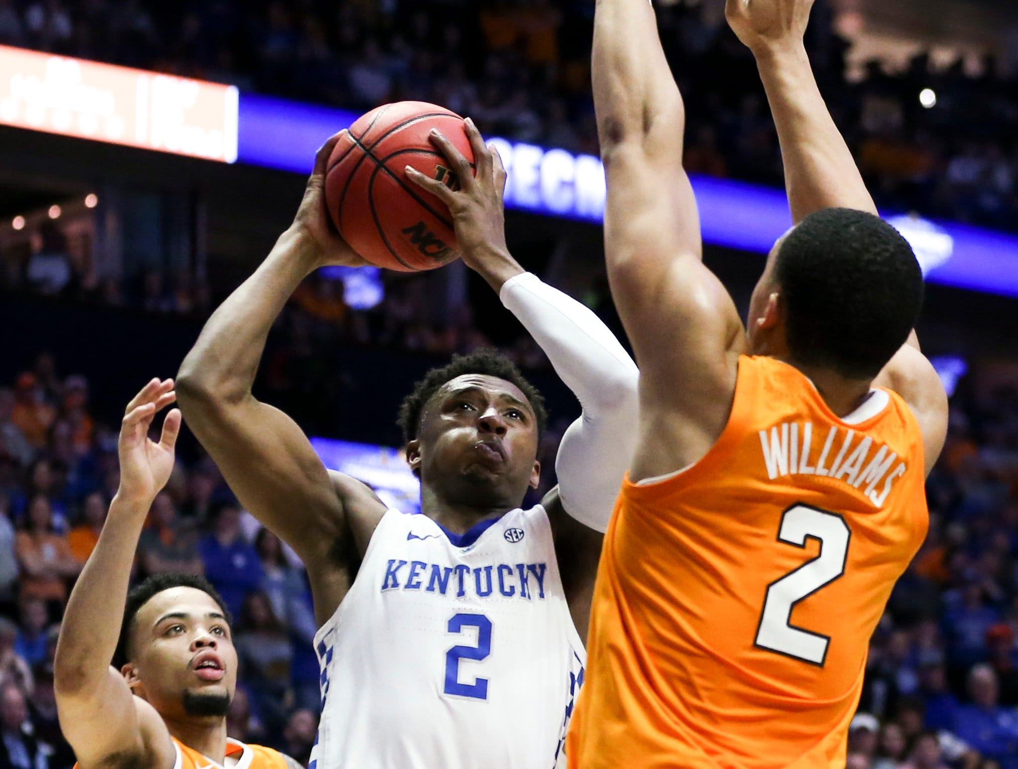Kentucky guard Ashton Hagans (2) shoots into Tennessee forward Grant Williams (2) during the first half of the SEC Men's Basketball Tournament semifinal game at Bridgestone Arena in Nashville, Tenn., Saturday, March 16, 2019.