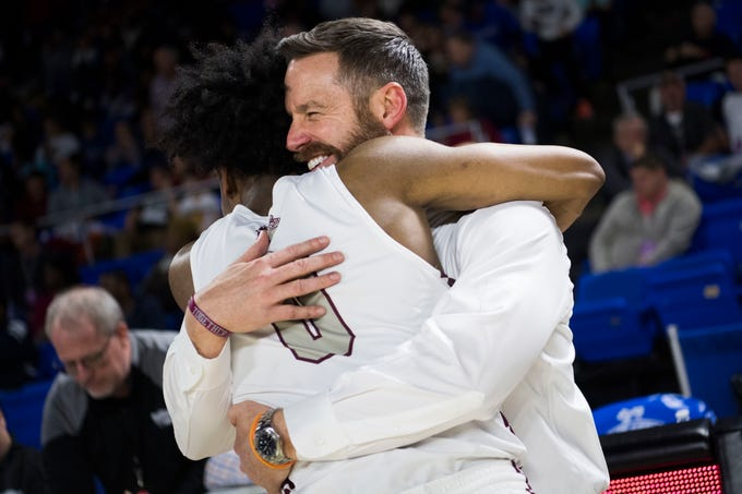 Bearden's head coach Jeremy Parrott hugs Bearden's Ques Glover (0) after a TSSAA AAA state championship victory over Memphis East at the Murphy Center in Murfreesboro, Saturday, March 16, 2019. Bearden defeated East 83-68.