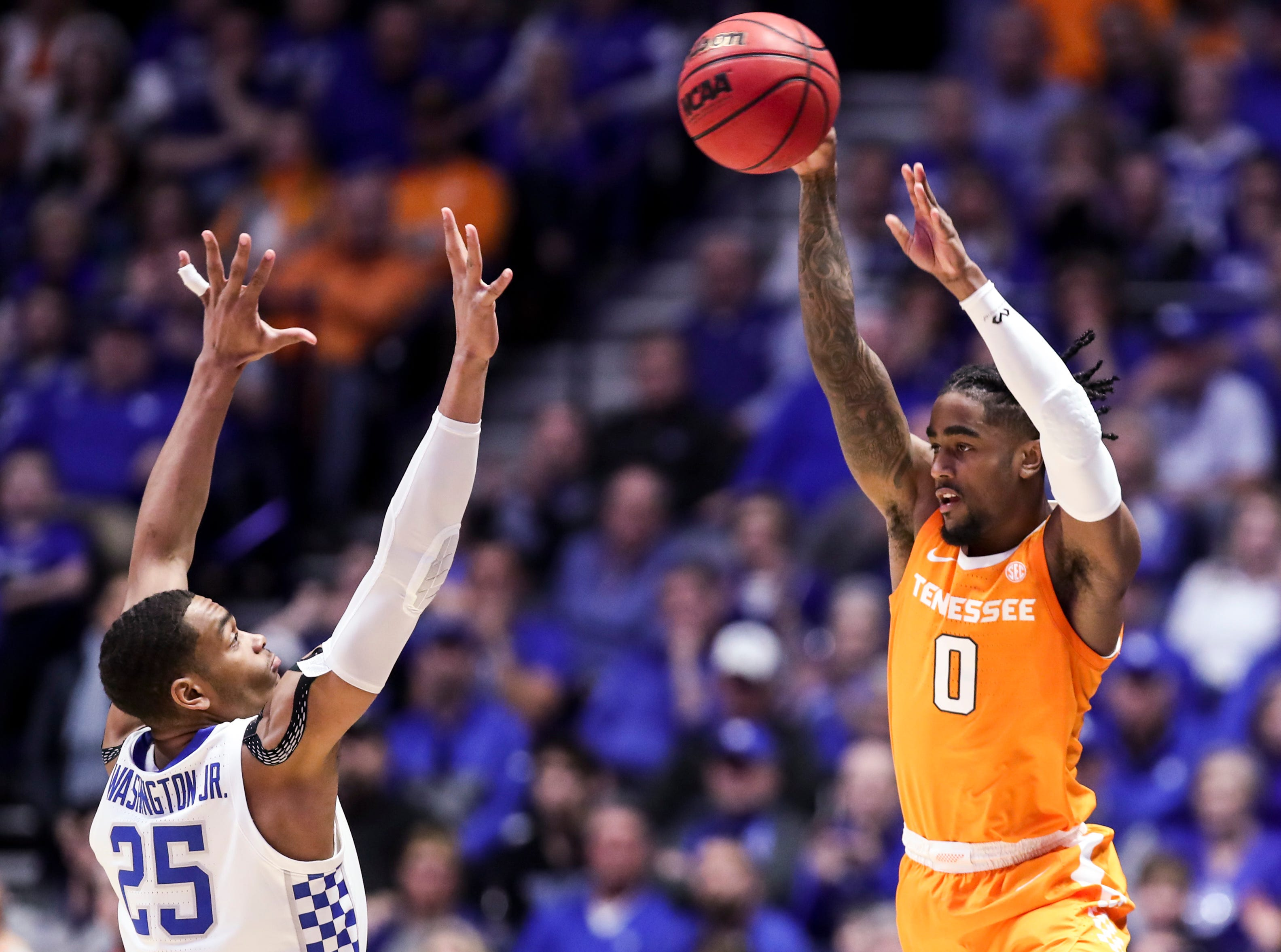 Tennessee guard Jordan Bone (0) shoots over Kentucky forward PJ Washington (25) during the second half of the SEC Men's Basketball Tournament semifinal game at Bridgestone Arena in Nashville, Tenn., Saturday, March 16, 2019.