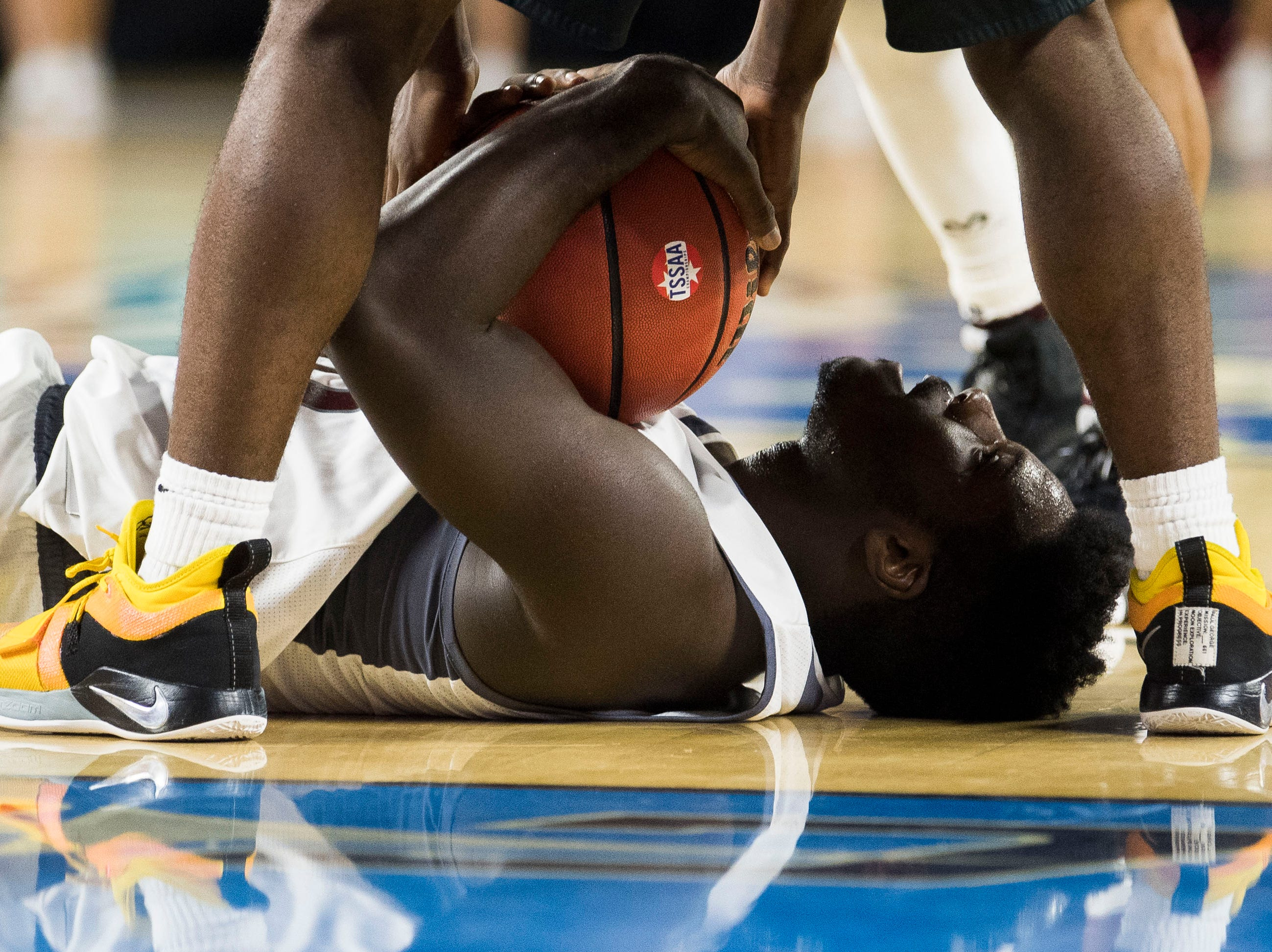 Fulton's Jashaun Fenderson (30) lays on the floor during a TSSAA AA state championship game between Wooddale and Fulton at the Murphy Center in Murfreesboro, Saturday, March 16, 2019.