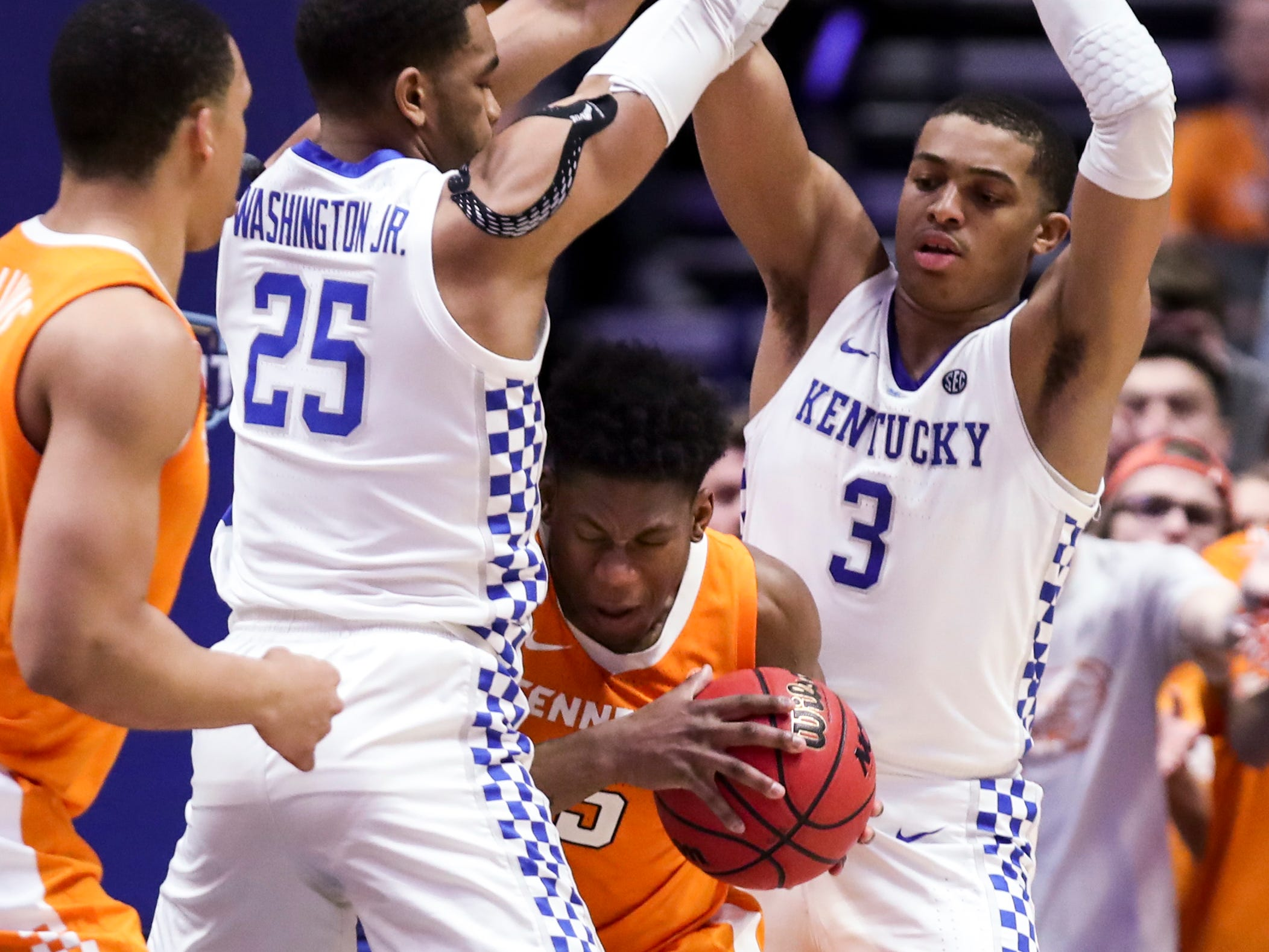 Kentucky forward PJ Washington (25) and guard Keldon Johnson (3) guard Tennessee guard Admiral Schofield (5) during the second half of the SEC Men's Basketball Tournament semifinal game at Bridgestone Arena in Nashville, Tenn., Saturday, March 16, 2019.