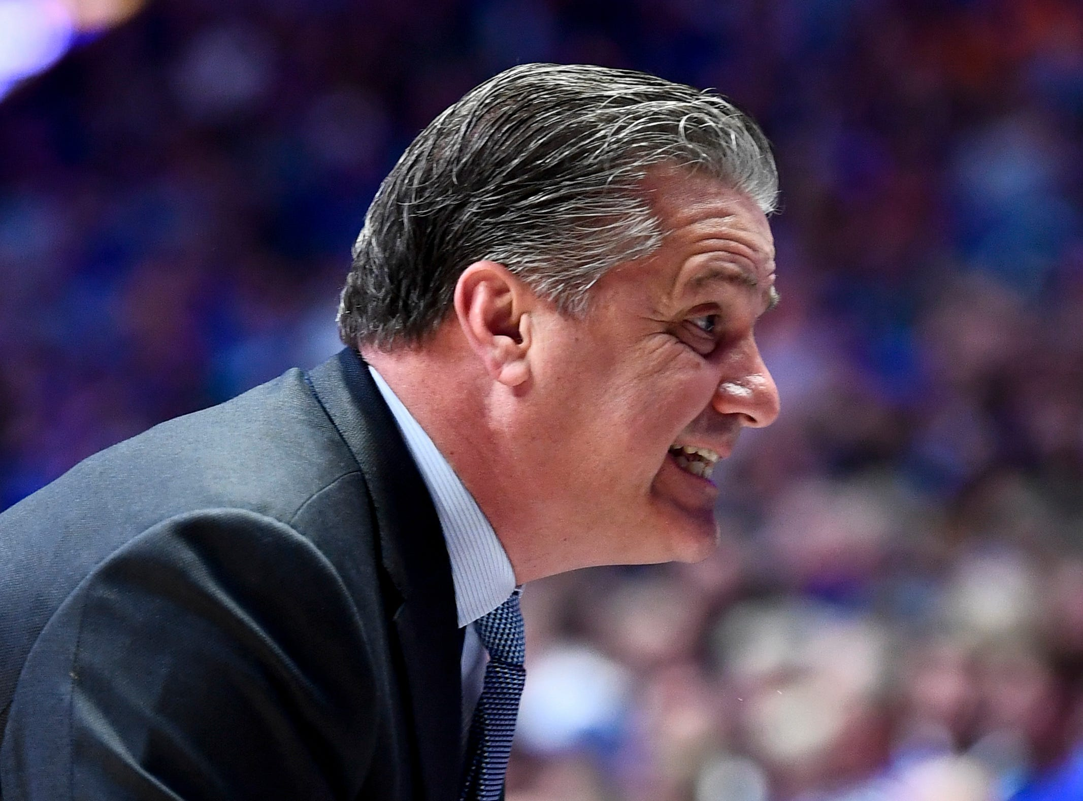 Kentucky head coach John Calipari works with his team against Tennessee during the first half of the SEC Men's Basketball Tournament semifinal game at Bridgestone Arena in Nashville, Tenn., Saturday, March 16, 2019.