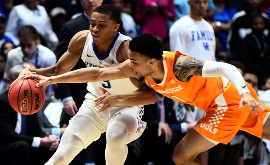 Kentucky guard Keldon Johnson (3) moves the ball defended by Tennessee guard Lamonte Turner (1) during the second half of the SEC Men's Basketball Tournament game at Bridgestone Arena in Nashville, Tenn., Saturday, March 16, 2019.