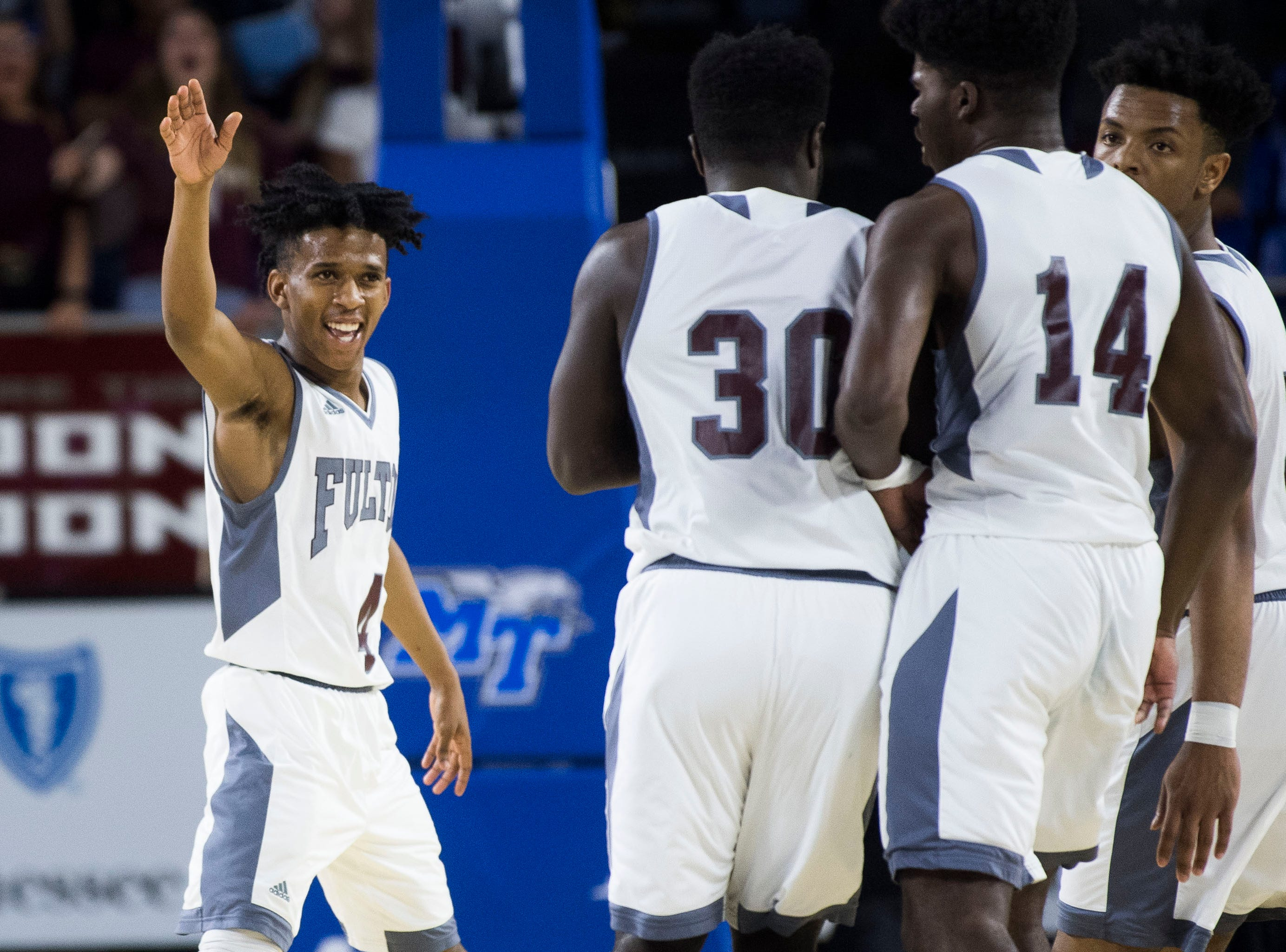 Fulton's Edward Lacy (4) congratulates a teammate on a three-point shot. Lacy, along with Ron Davis III and Deshawn Page, were named to the Class-AA All-Tournament Team. TSSAA Class-AA state championship game between Wooddale and Fulton at the Murphy Center in Murfreesboro, Saturday, March 16, 2019.