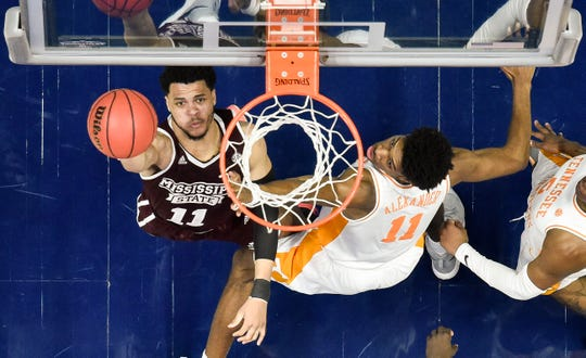 Mississippi State guard Quinndary Weatherspoon (11) battles Tennessee forward Kyle Alexander (11) during the second half of the SEC Men's Basketball Tournament game at Bridgestone Arena in Nashville, Tenn., Friday, March 15, 2019.