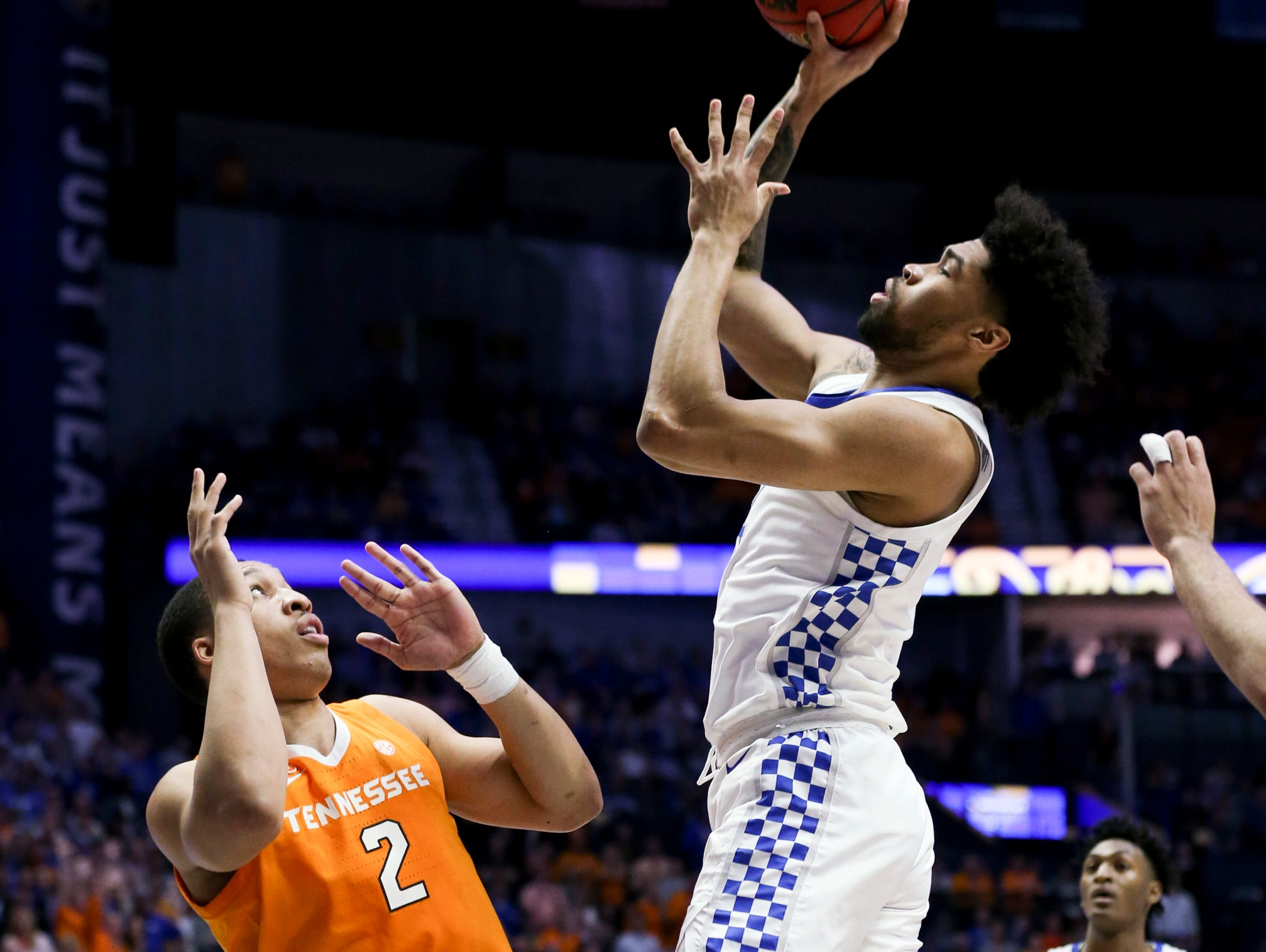 Kentucky forward Nick Richards (4) shoots past Tennessee forward Grant Williams (2) during the first half of the SEC Men's Basketball Tournament semifinal game at Bridgestone Arena in Nashville, Tenn., Saturday, March 16, 2019.