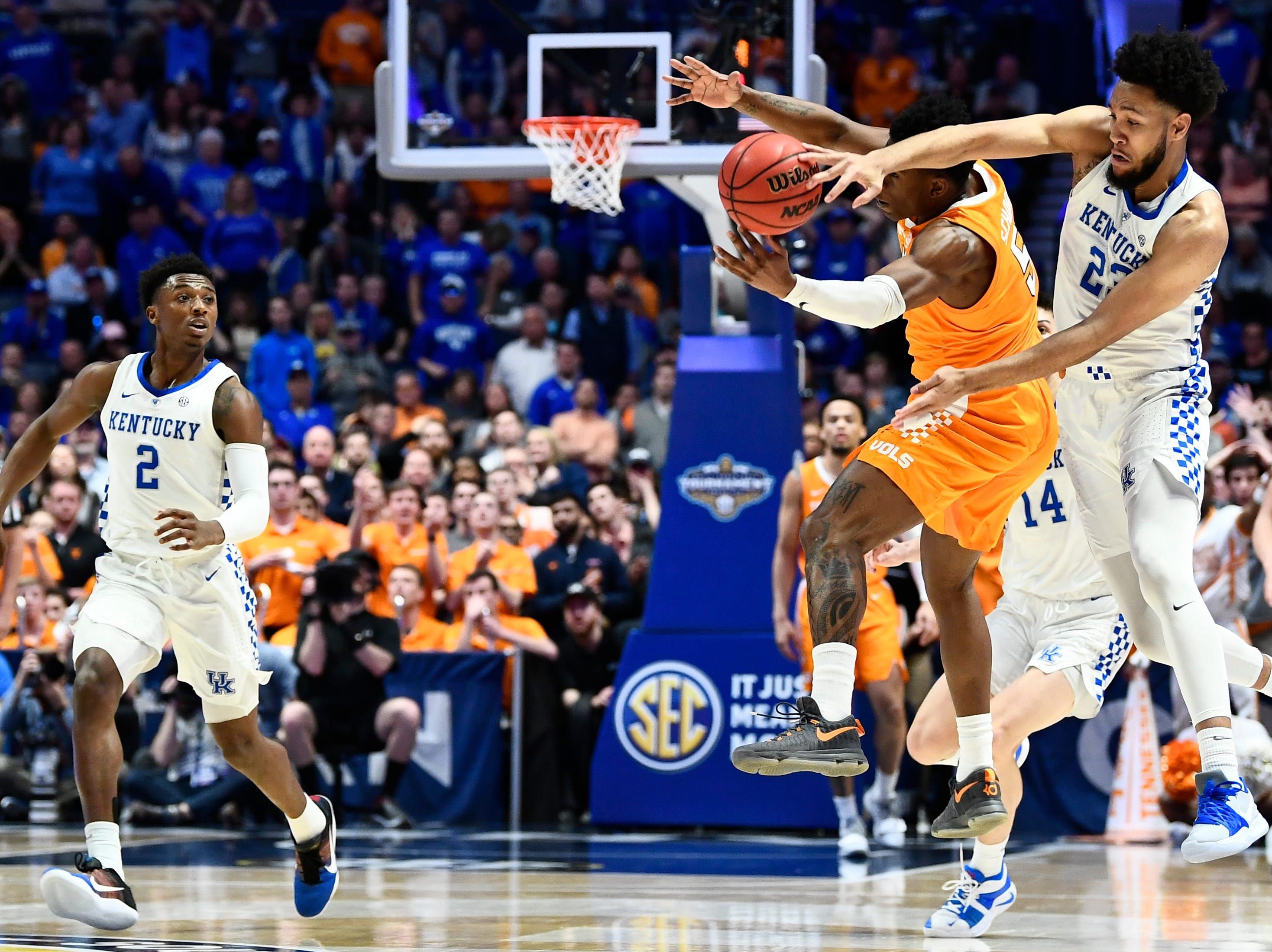 Tennessee guard Admiral Schofield (5) battles Kentucky forward EJ Montgomery (23) during the first half of the SEC Men's Basketball Tournament semifinal game at Bridgestone Arena in Nashville, Tenn., Saturday, March 16, 2019.