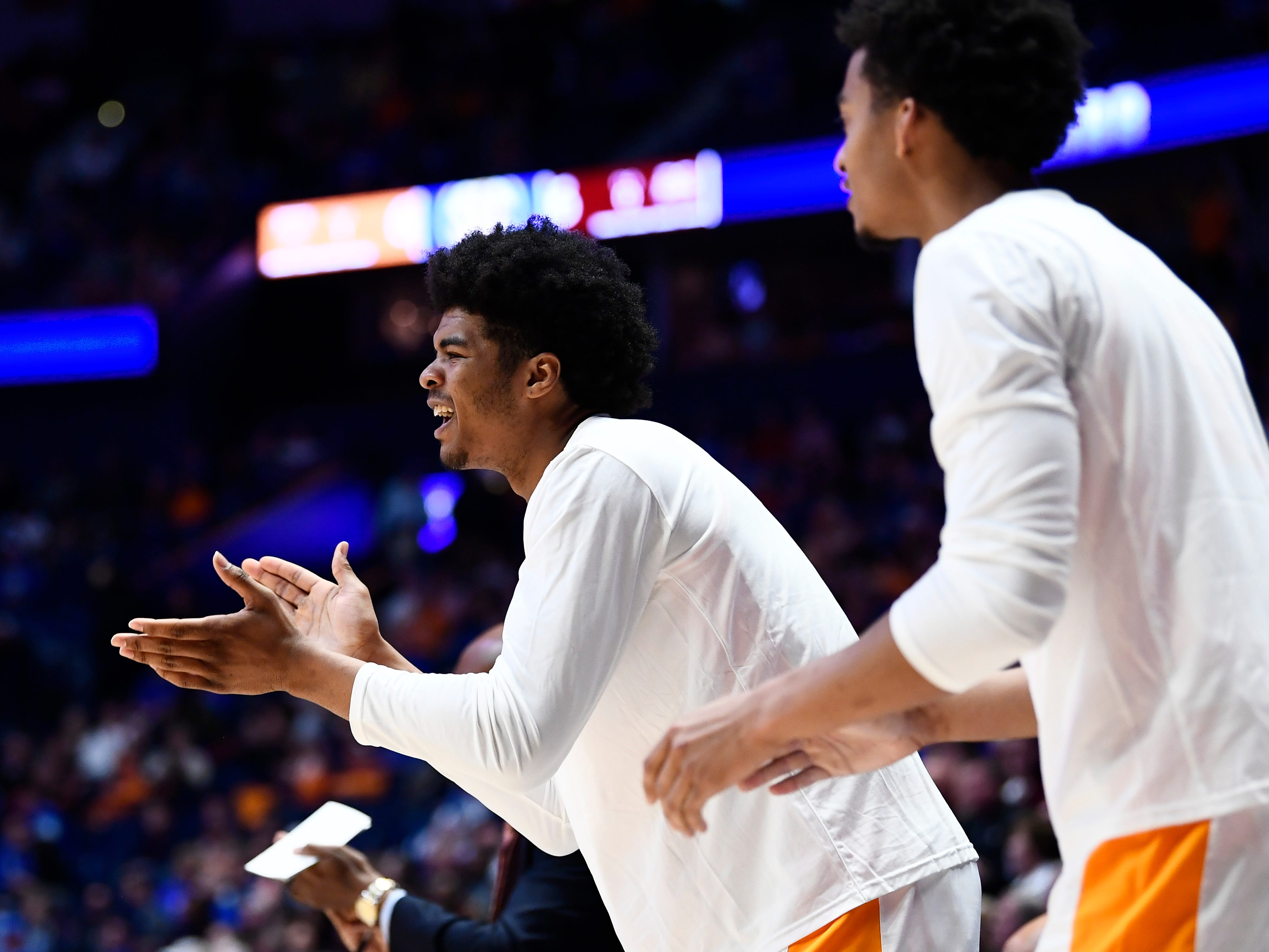 Tennessee forward Derrick Walker (15) cheers his teammates during the first half of the SEC Men's Basketball Tournament game against Mississippi State at Bridgestone Arena in Nashville, Tenn., Friday, March 15, 2019.