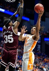 Tennessee forward Yves Pons (35) goes to the basket defended by Mississippi State forward Aric Holman (35) during the first half of the SEC Men's Basketball Tournament game at Bridgestone Arena in Nashville, Tenn., Friday, March 15, 2019.