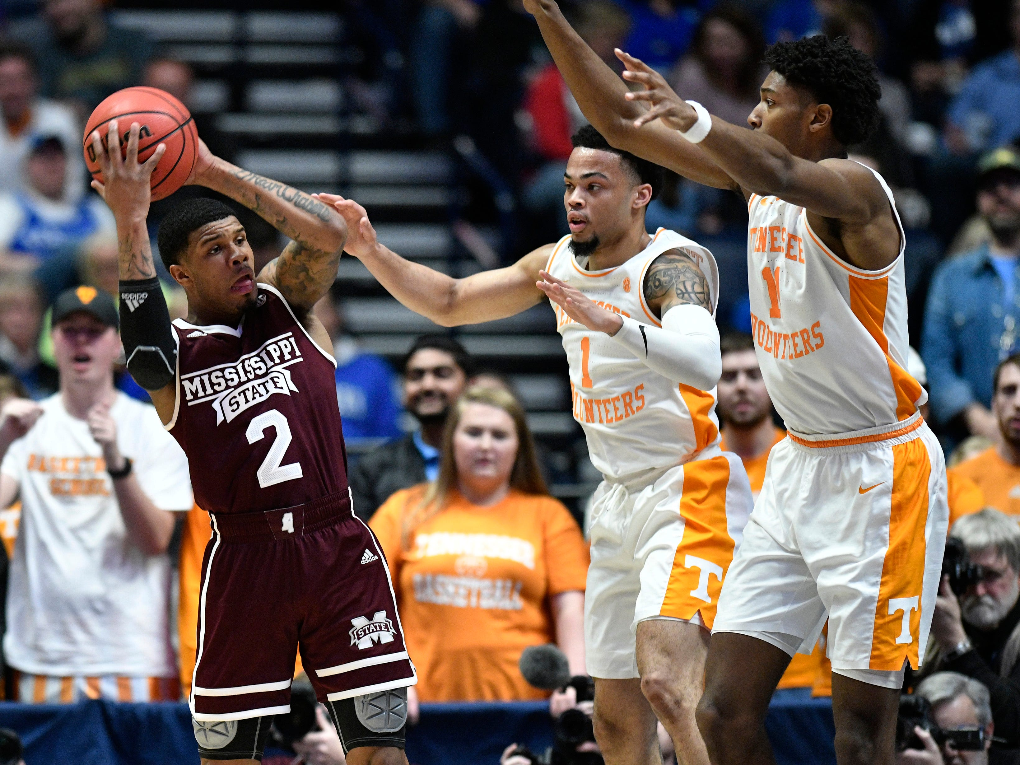 Mississippi State guard Lamar Peters (2) tries to move defended by Tennessee guard Lamonte Turner (1) and forward Kyle Alexander (11) during the first half of the SEC Men's Basketball Tournament game at Bridgestone Arena in Nashville, Tenn., Friday, March 15, 2019.