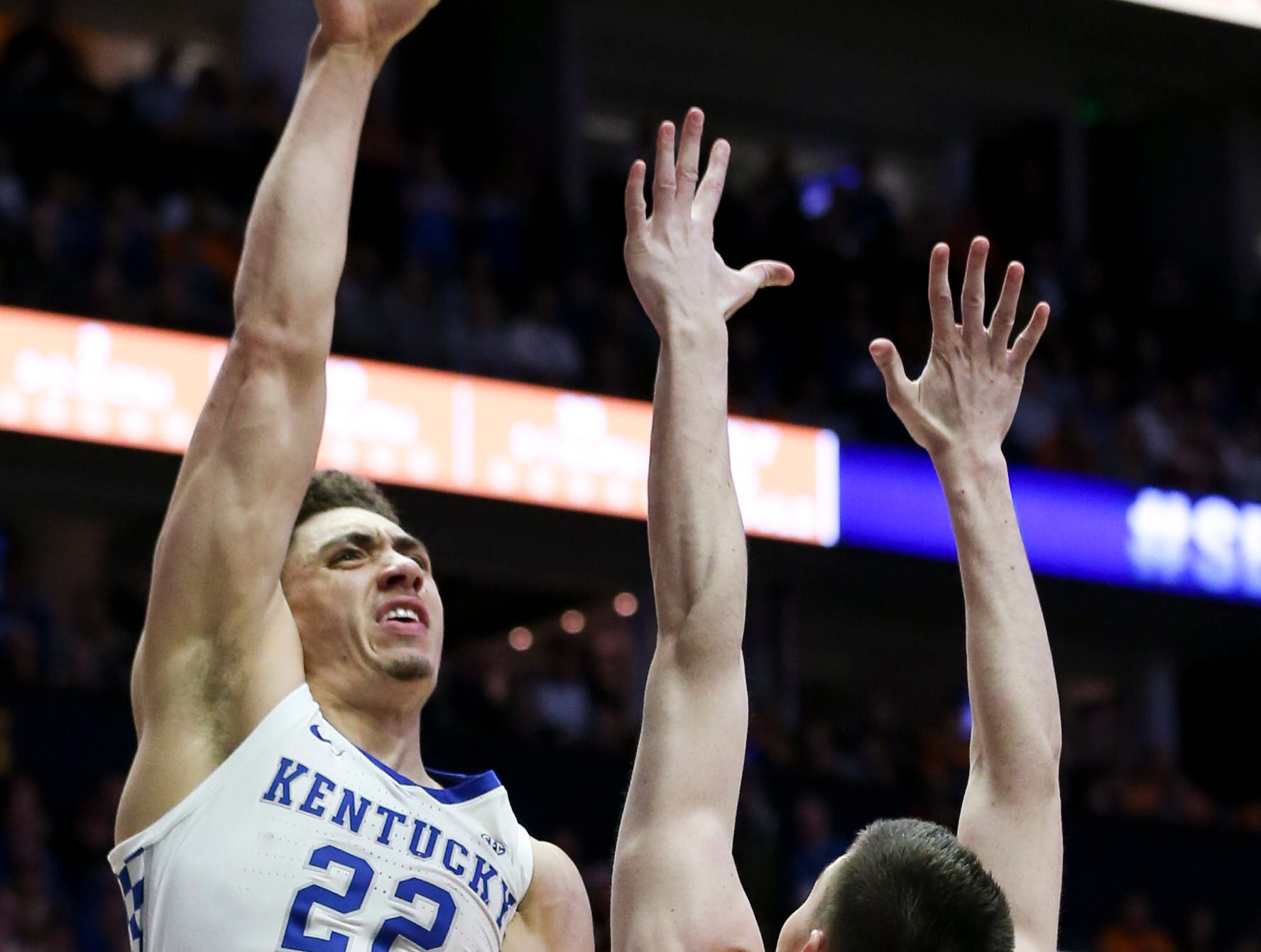Kentucky forward Reid Travis (22) shoots over Tennessee forward John Fulkerson (10) during the first half of the SEC Men's Basketball Tournament semifinal game at Bridgestone Arena in Nashville, Tenn., Saturday, March 16, 2019.