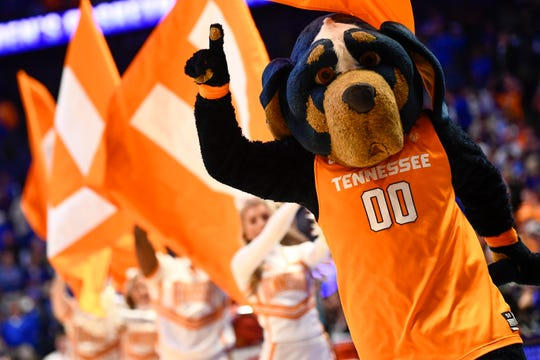 Smokey leads Tennessee onto the court before the SEC Men's Basketball Tournament semifinal game against Kentucky at Bridgestone Arena in Nashville on March 16, 2019.