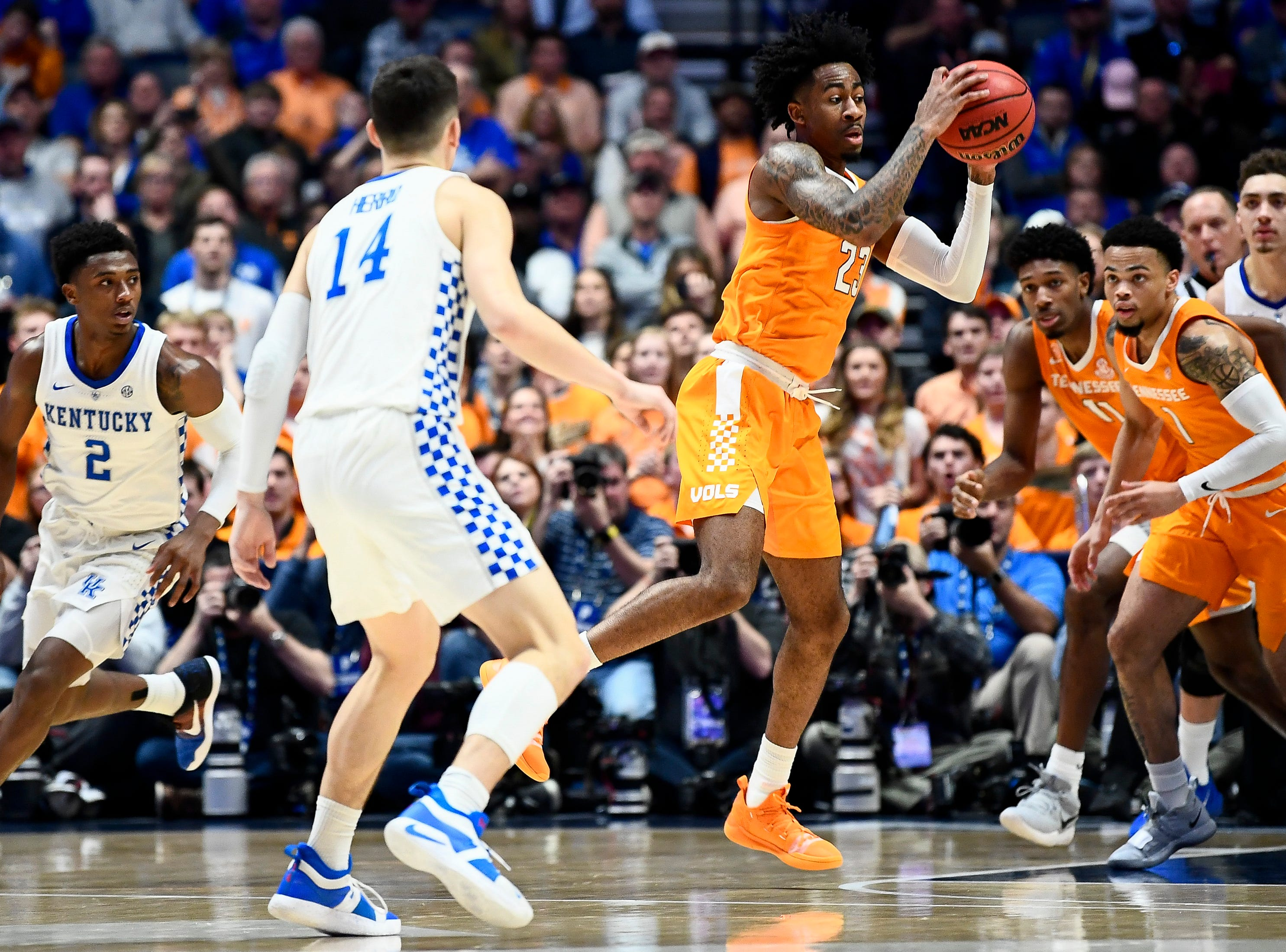 Tennessee guard Jordan Bowden (23) moves the ball against Kentucky during the first half of the SEC Men's Basketball Tournament semifinal game at Bridgestone Arena in Nashville, Tenn., Saturday, March 16, 2019.
