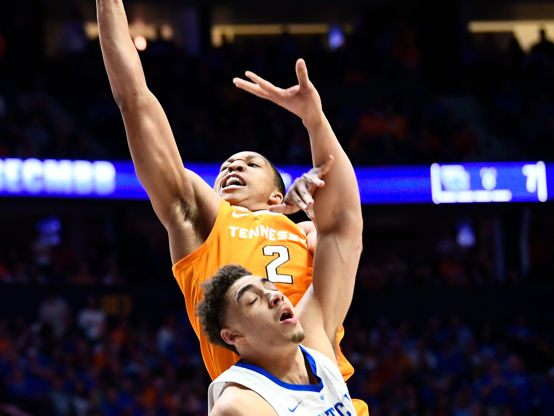 Tennessee forward Grant Williams (2) shoots over Kentucky forward Reid Travis (22) during the first half of the SEC Men's Basketball Tournament semifinal game at Bridgestone Arena in Nashville, Tenn., Saturday, March 16, 2019.