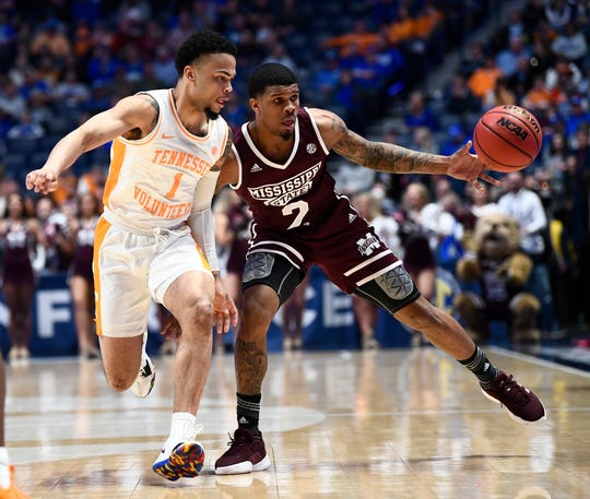 Mississippi State guard Lamar Peters (2) loses the ball while defended by Tennessee guard Lamonte Turner (1) during the first half of the SEC Men's Basketball Tournament game at Bridgestone Arena in Nashville, Tenn., Friday, March 15, 2019.