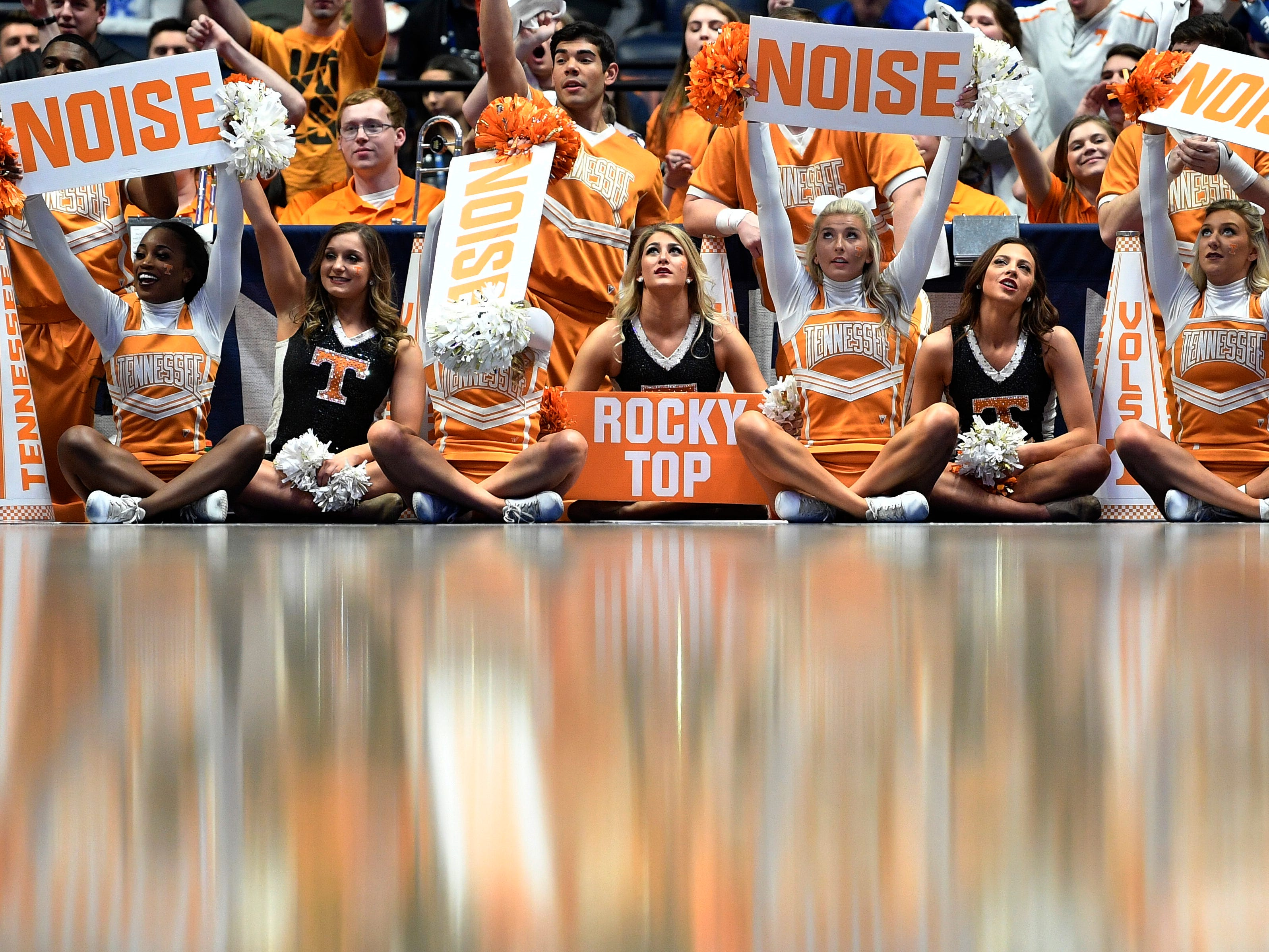 Tennessee cheerleaders lead the fans during the first half of the SEC Men's Basketball Tournament game against Mississippi State at Bridgestone Arena in Nashville, Tenn., Friday, March 15, 2019.