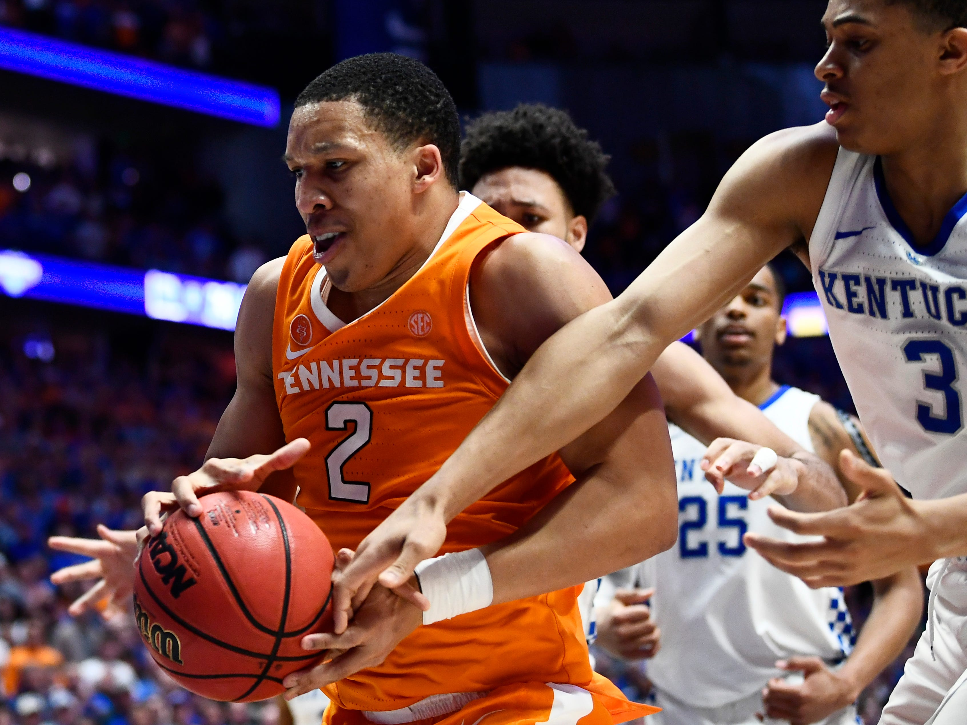 Tennessee forward Grant Williams (2) comes down with a rebound defended by Kentucky guard Keldon Johnson (3) during the second half of the SEC Men's Basketball Tournament game at Bridgestone Arena in Nashville, Tenn., Saturday, March 16, 2019.