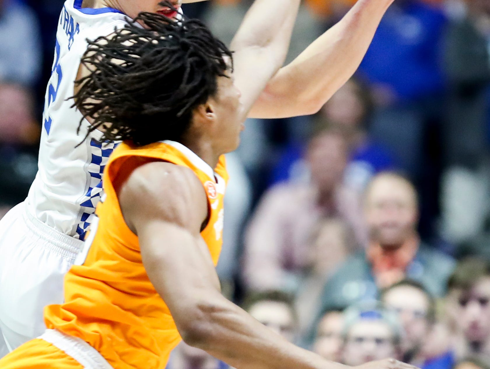Tennessee forward Yves Pons (35) battles for the ball with Kentucky forward Reid Travis (22) during the first half of the SEC Men's Basketball Tournament semifinal game at Bridgestone Arena in Nashville, Tenn., Saturday, March 16, 2019.