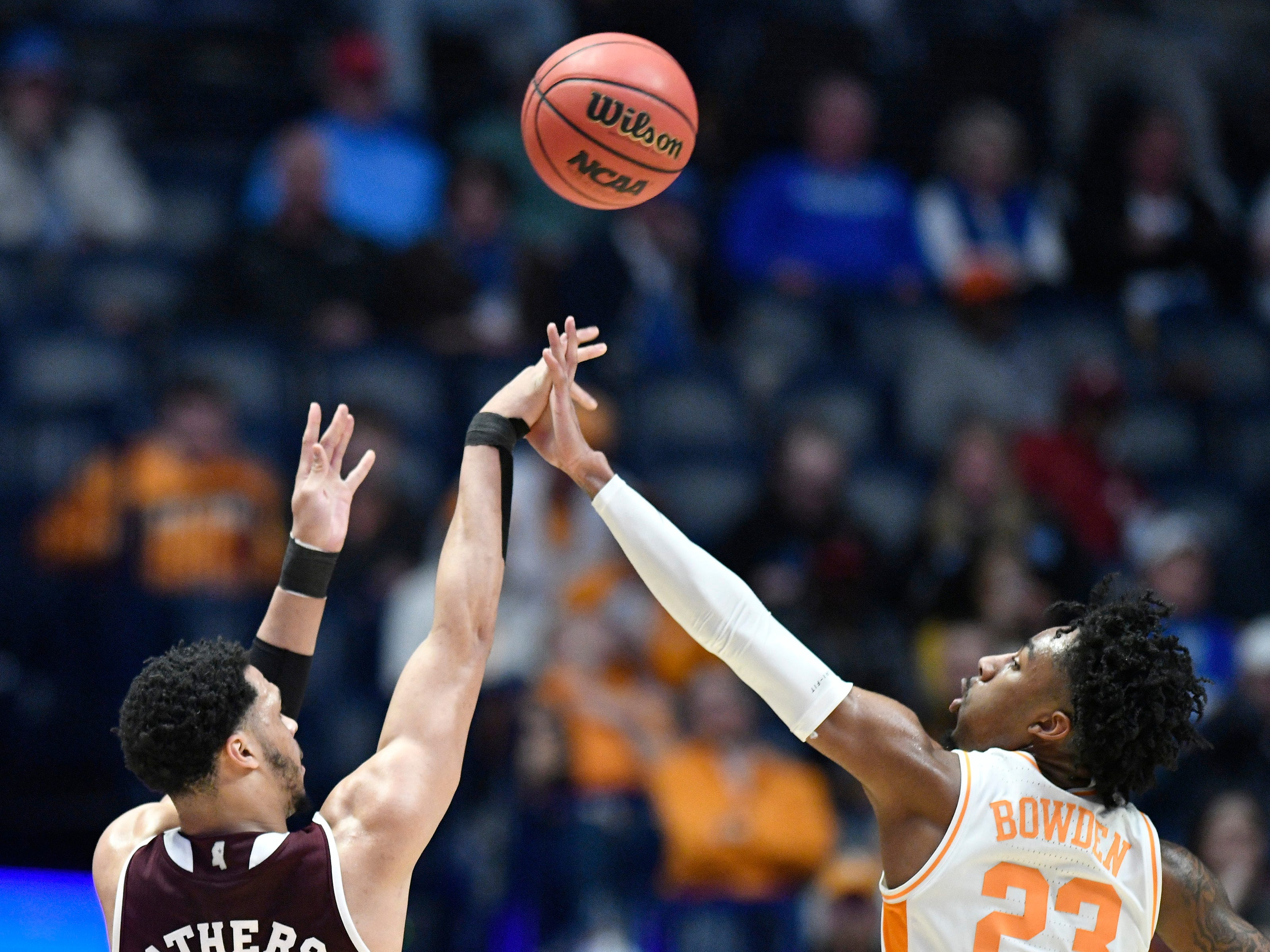 Mississippi State guard Quinndary Weatherspoon (11) shoots while defended by Tennessee guard Jordan Bowden (23) during the first half of the SEC Men's Basketball Tournament game at Bridgestone Arena in Nashville, Tenn., Friday, March 15, 2019.