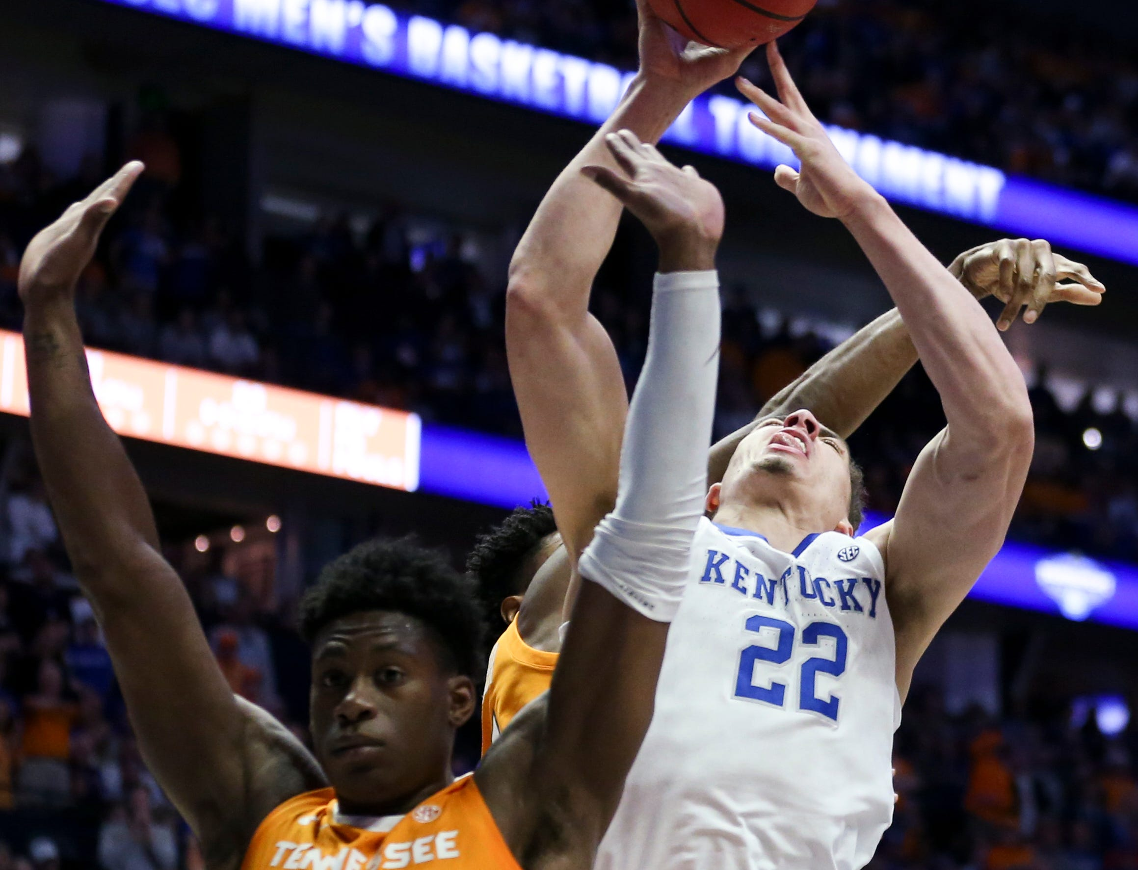 Kentucky forward Reid Travis (22) shoots against Tennessee guard Admiral Schofield (5) during the first half of the SEC Men's Basketball Tournament semifinal game at Bridgestone Arena in Nashville, Tenn., Saturday, March 16, 2019.