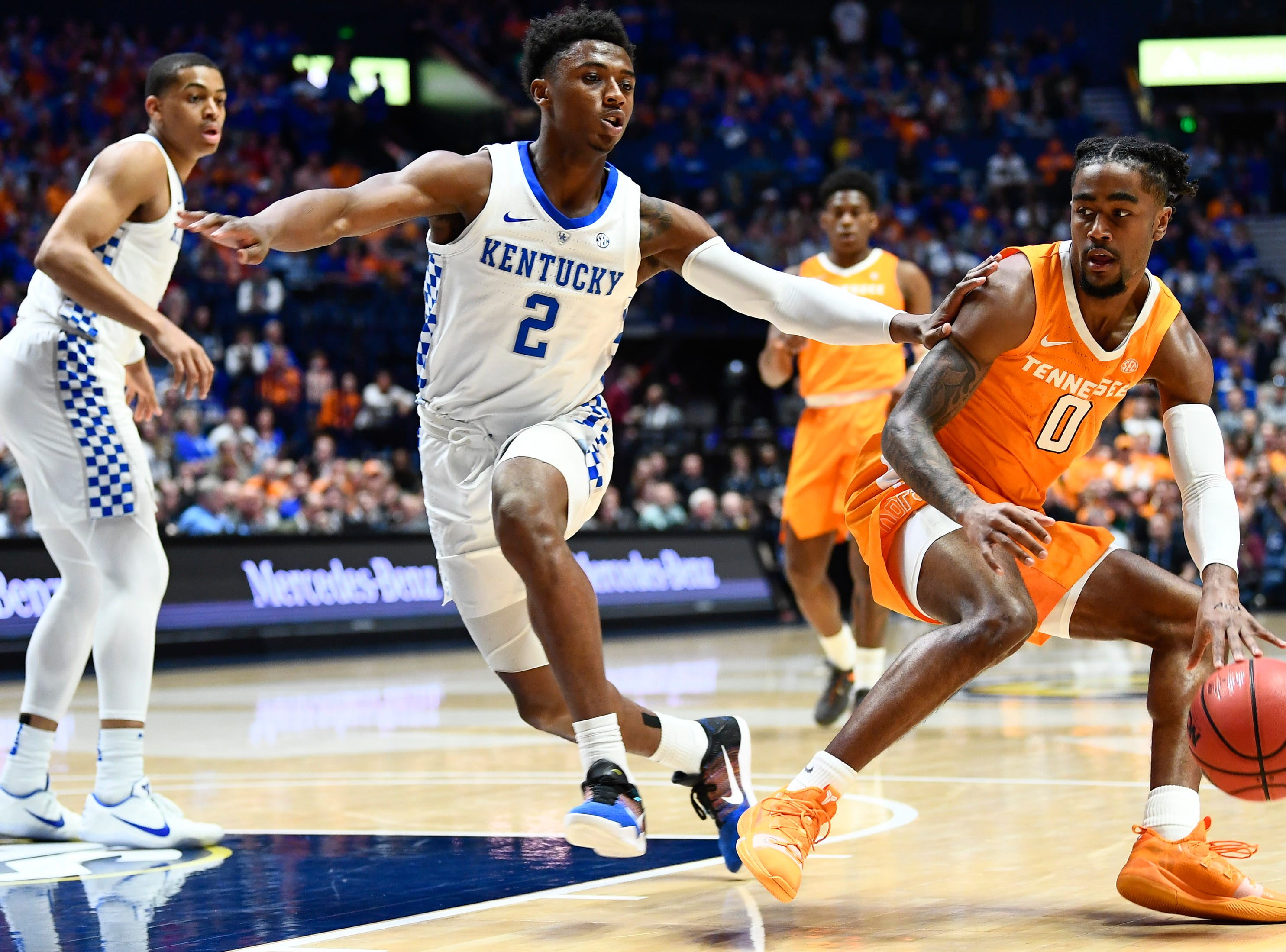 Tennessee guard Jordan Bone (0) looks for an opening past Kentucky guard Ashton Hagans (2) during the first half of the SEC Men's Basketball Tournament semifinal game at Bridgestone Arena in Nashville, Tenn., Saturday, March 16, 2019.