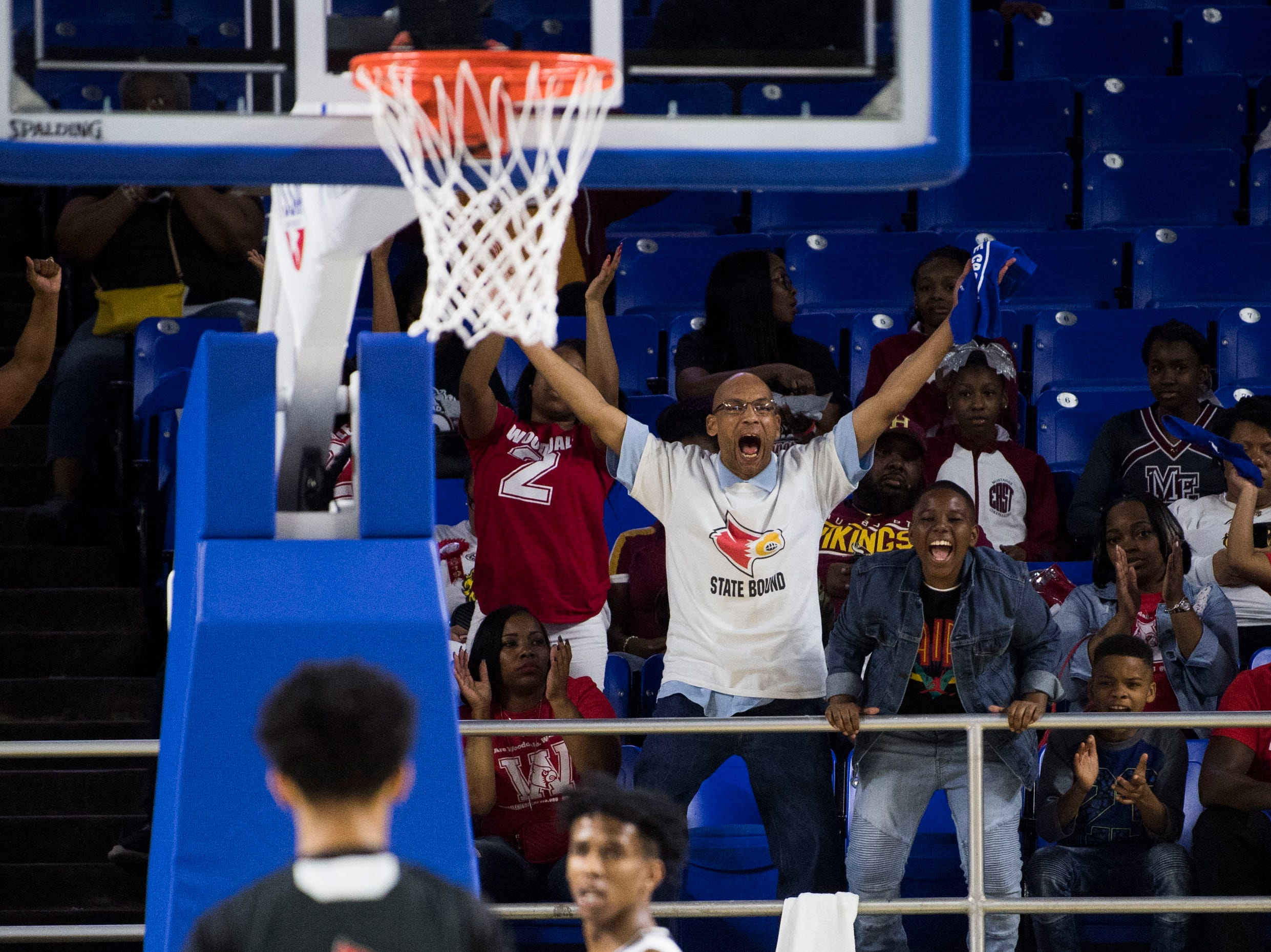 Wooddale fans react to a basket during a TSSAA AA state championship game between Wooddale and Fulton at the Murphy Center in Murfreesboro, Saturday, March 16, 2019.