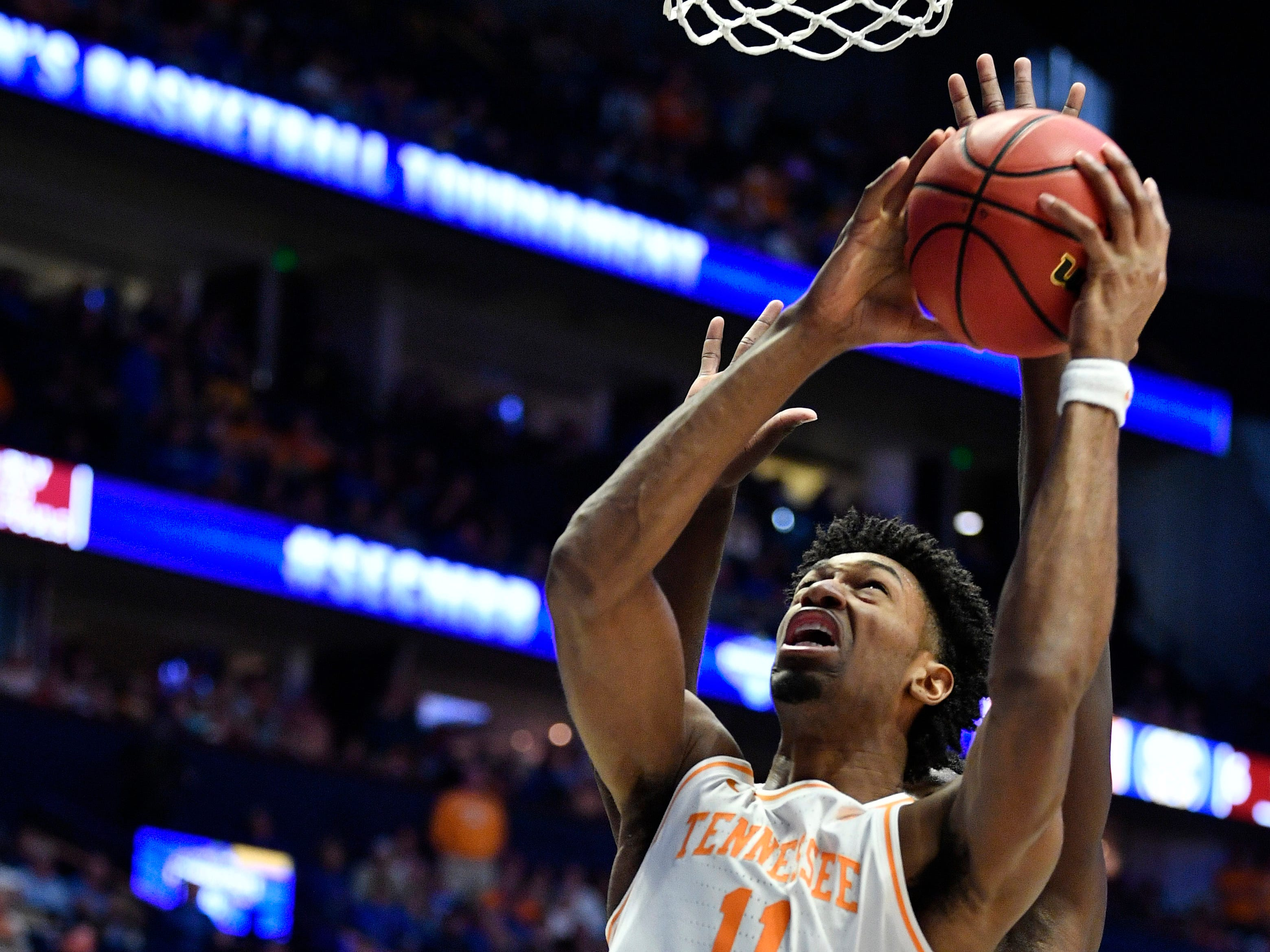 Tennessee forward Kyle Alexander (11) goes up for a shot during the first half of the SEC Men's Basketball Tournament game against Mississippi State at Bridgestone Arena in Nashville, Tenn., Friday, March 15, 2019.