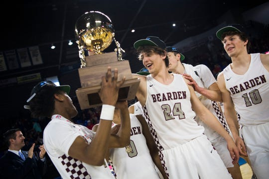Bearden holds up their trophy after a TSSAA AAA state championship game against Memphis East at the Murphy Center in Murfreesboro, Saturday, March 16, 2019. Bearden defeated East 83-68.