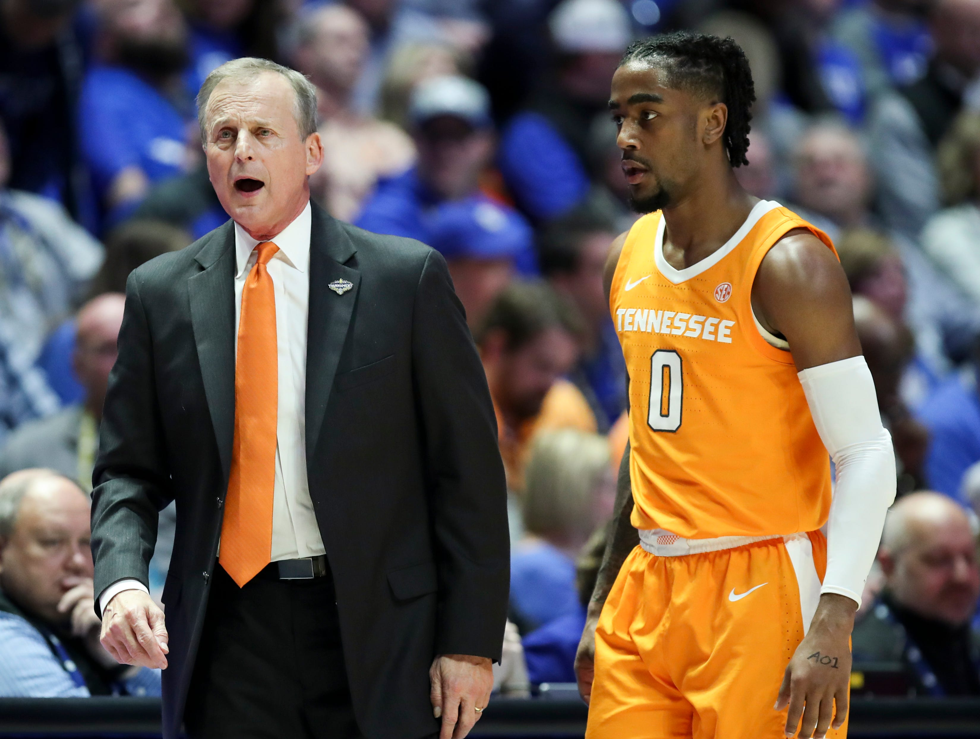 Tennessee head coach Rick Barnes works with guard Jordan Bone (0) during the first half of the SEC Men's Basketball Tournament semifinal game against Kentucky at Bridgestone Arena in Nashville, Tenn., Saturday, March 16, 2019.