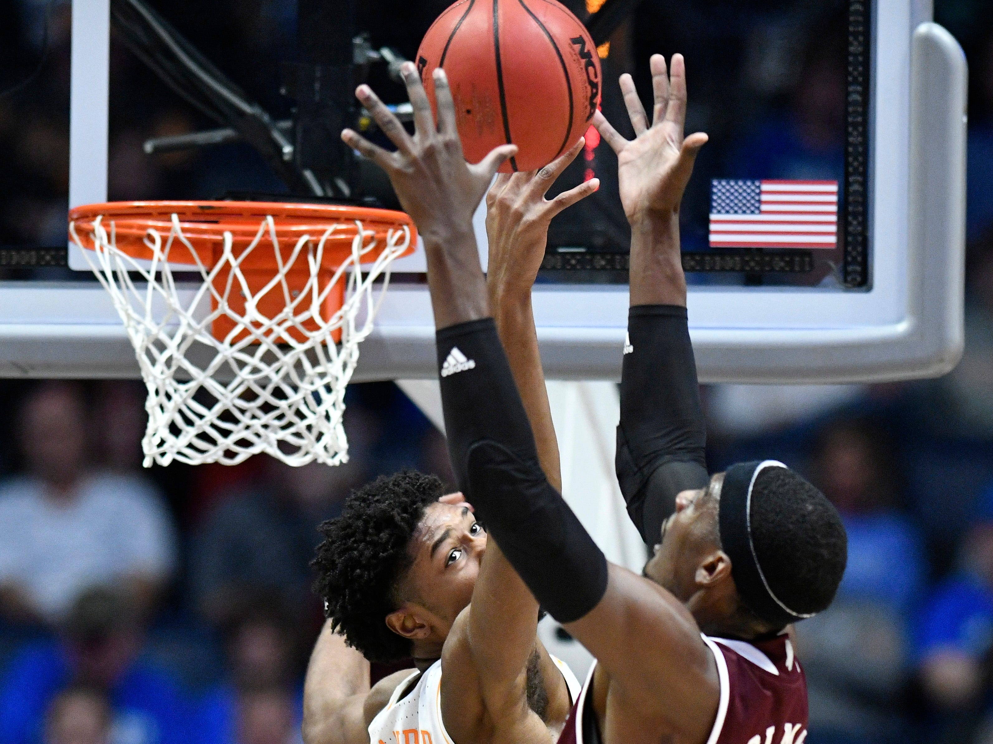 Mississippi State forward Aric Holman (35) battles for a rebound with Tennessee forward Kyle Alexander (11) during the first half of the SEC Men's Basketball Tournament game at Bridgestone Arena in Nashville, Tenn., Friday, March 15, 2019.